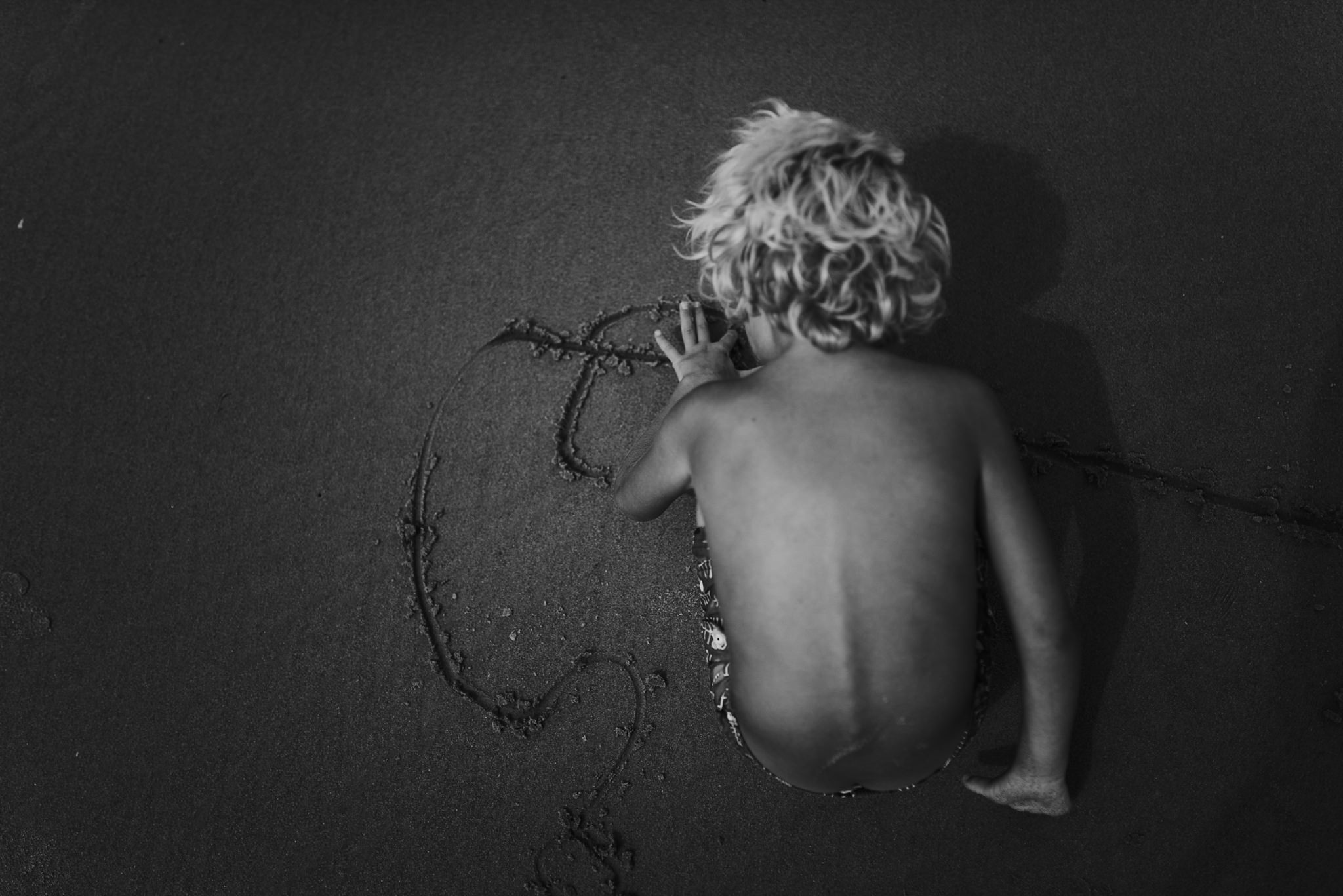 twyla jones photography - treasure coast florida - stormy beach boy playing in sand--15.jpg
