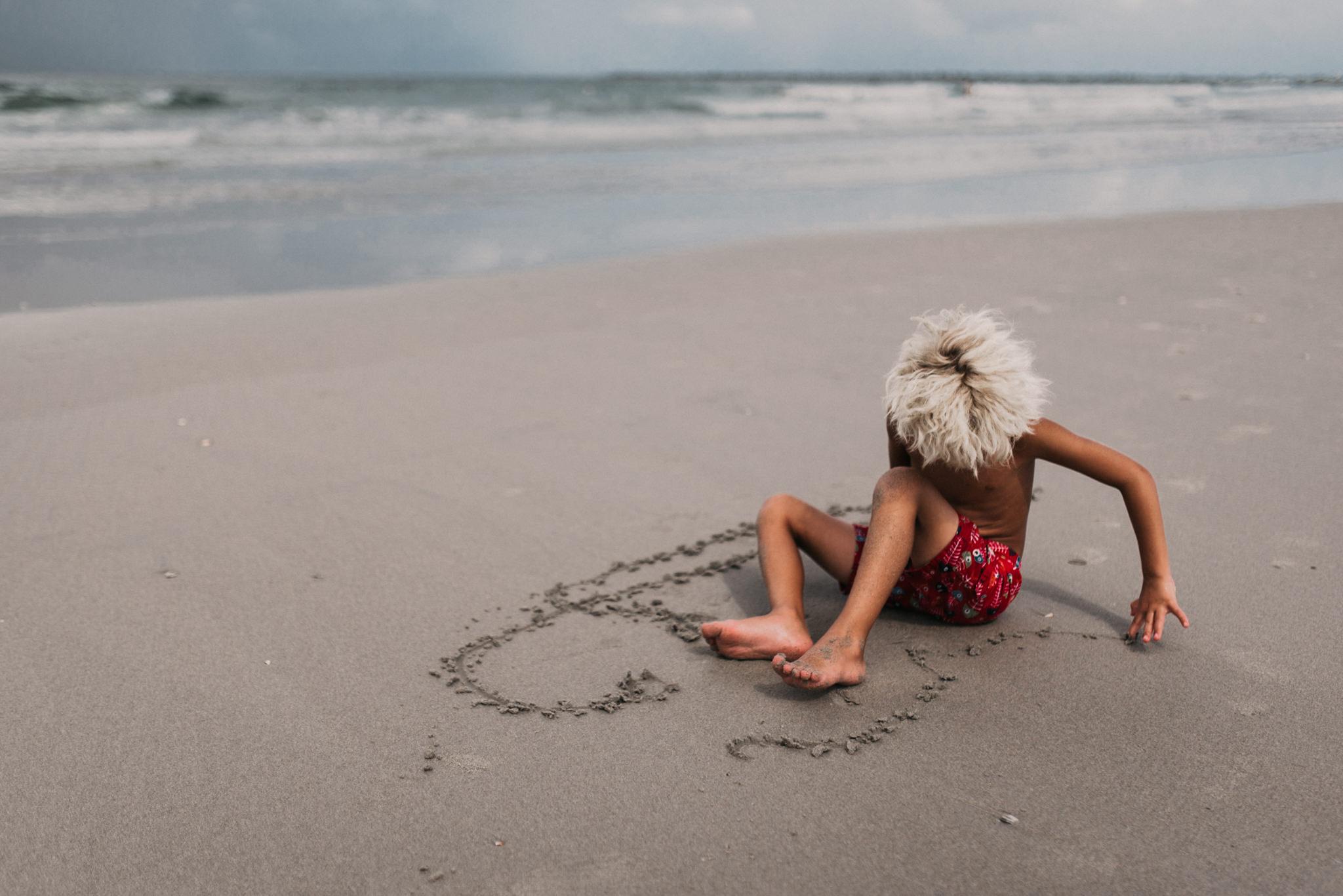 twyla jones photography - treasure coast florida - stormy beach boy playing in sand--17.jpg