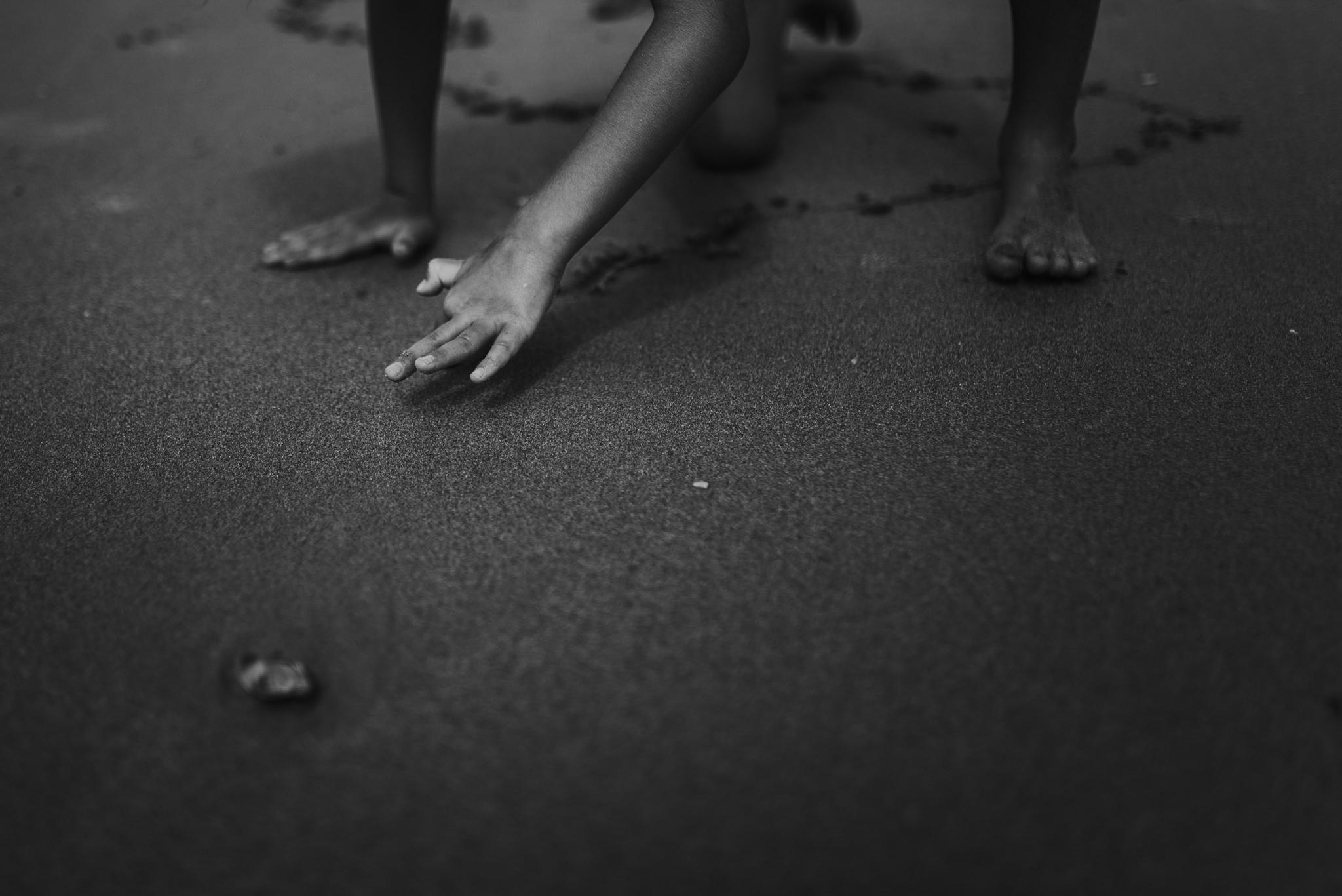 twyla jones photography - treasure coast florida - stormy beach boy playing in sand--19.jpg