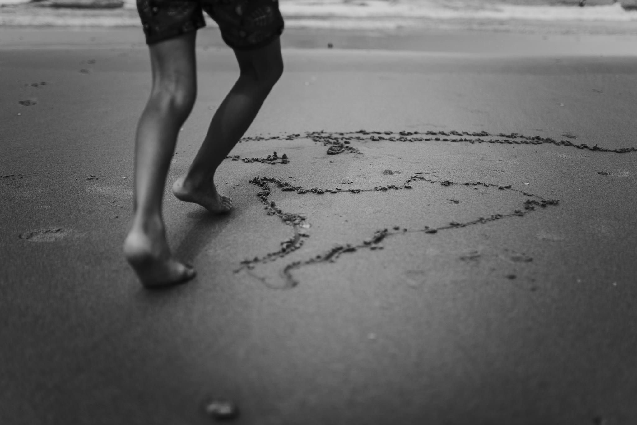 twyla jones photography - treasure coast florida - stormy beach boy playing in sand--21.jpg