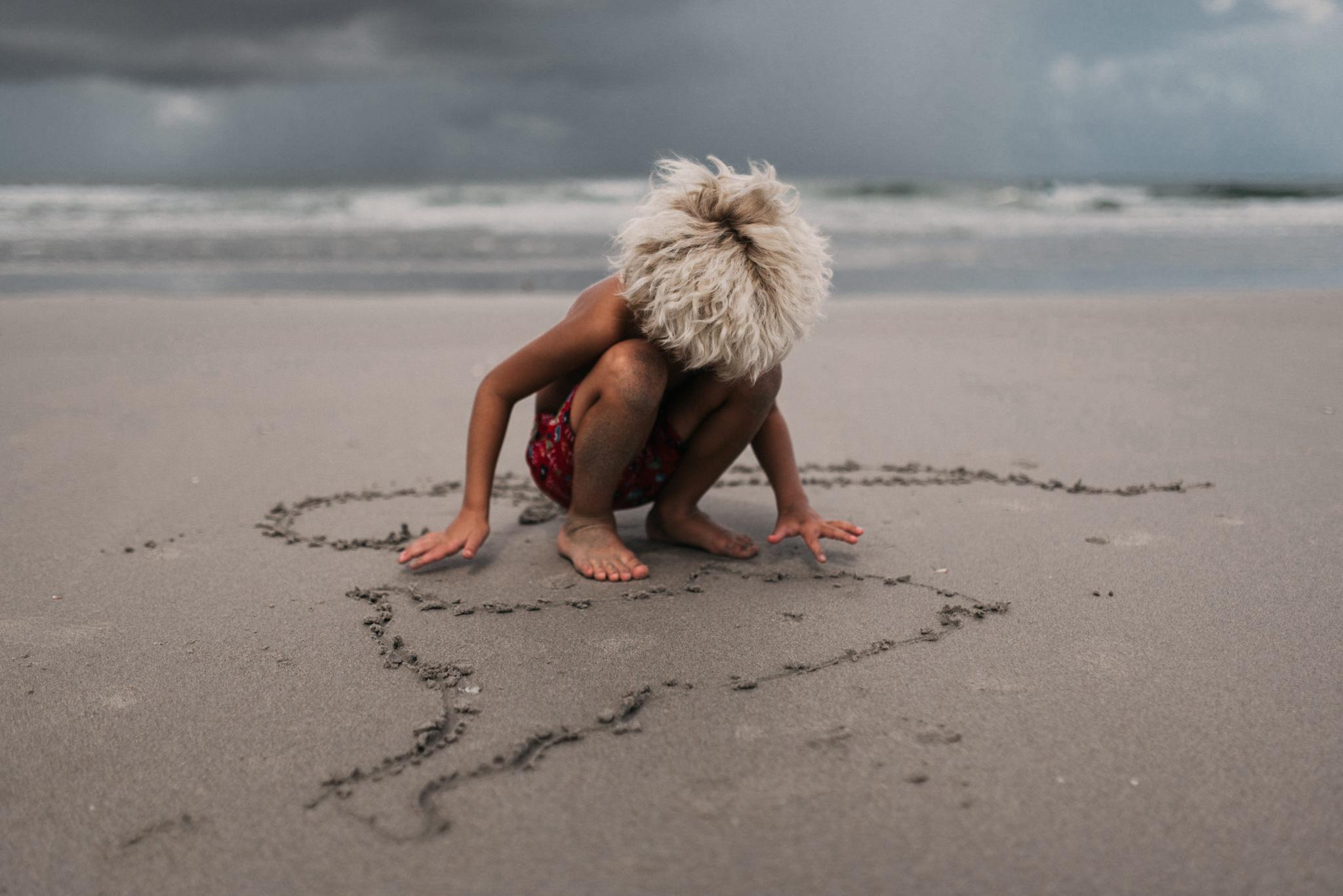 twyla jones photography - treasure coast florida - stormy beach boy playing in sand--22.jpg