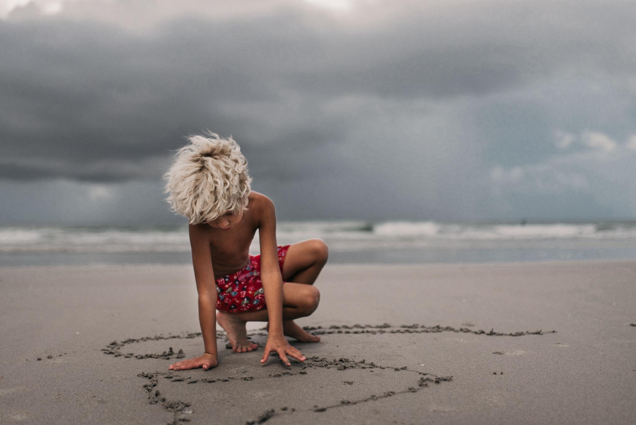 twyla jones photography - treasure coast florida - stormy beach boy playing in sand--23.jpg