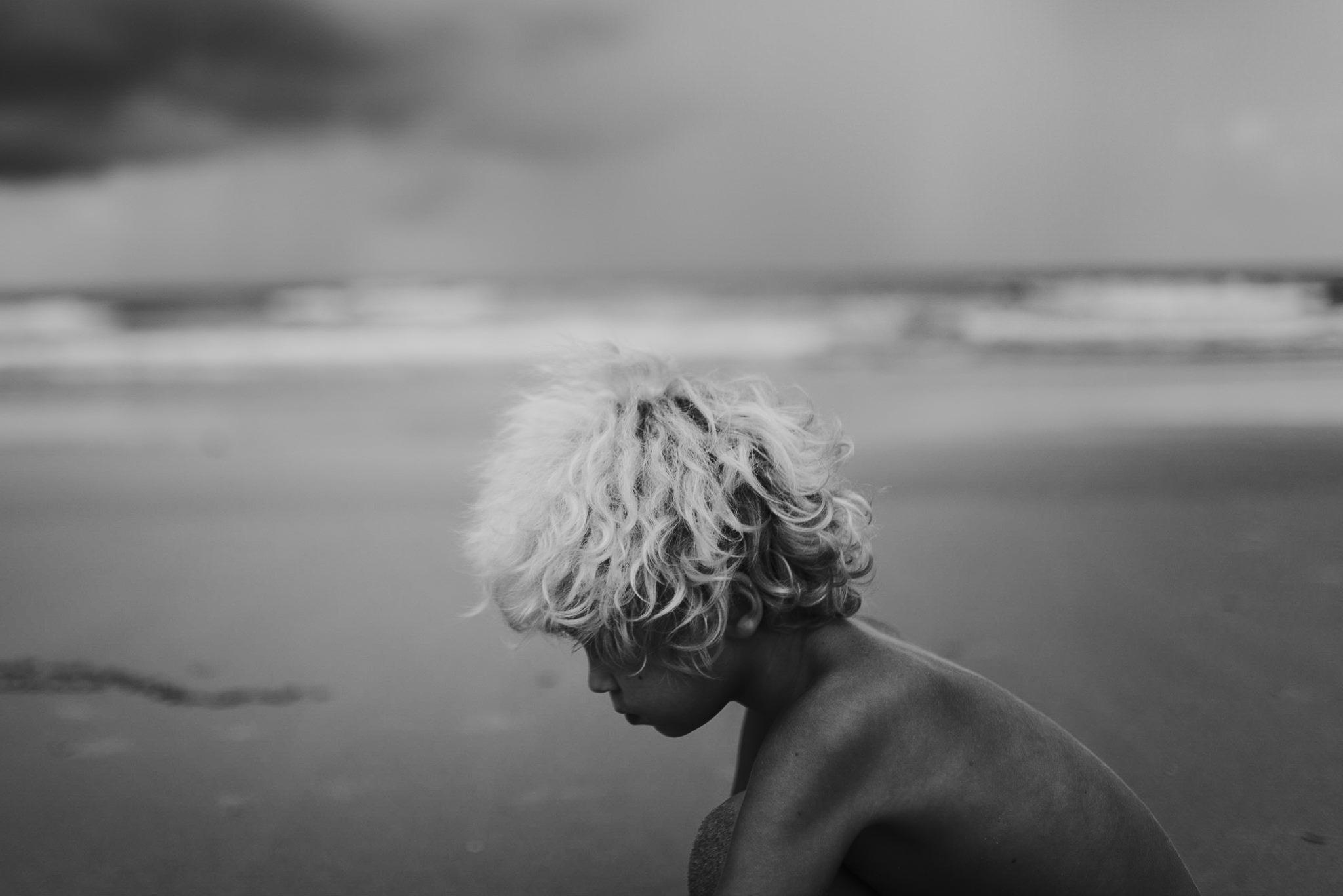 twyla jones photography - treasure coast florida - stormy beach boy playing in sand--27.jpg