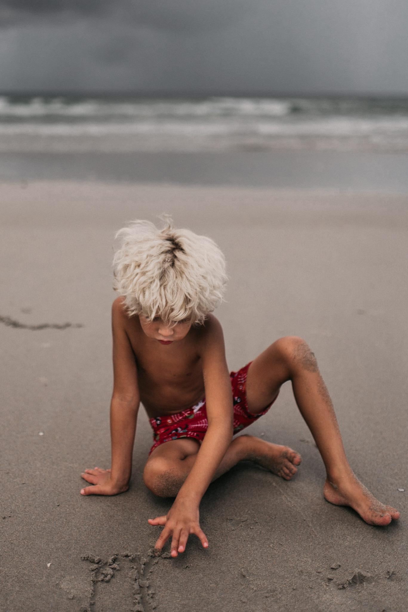 twyla jones photography - treasure coast florida - stormy beach boy playing in sand--28.jpg