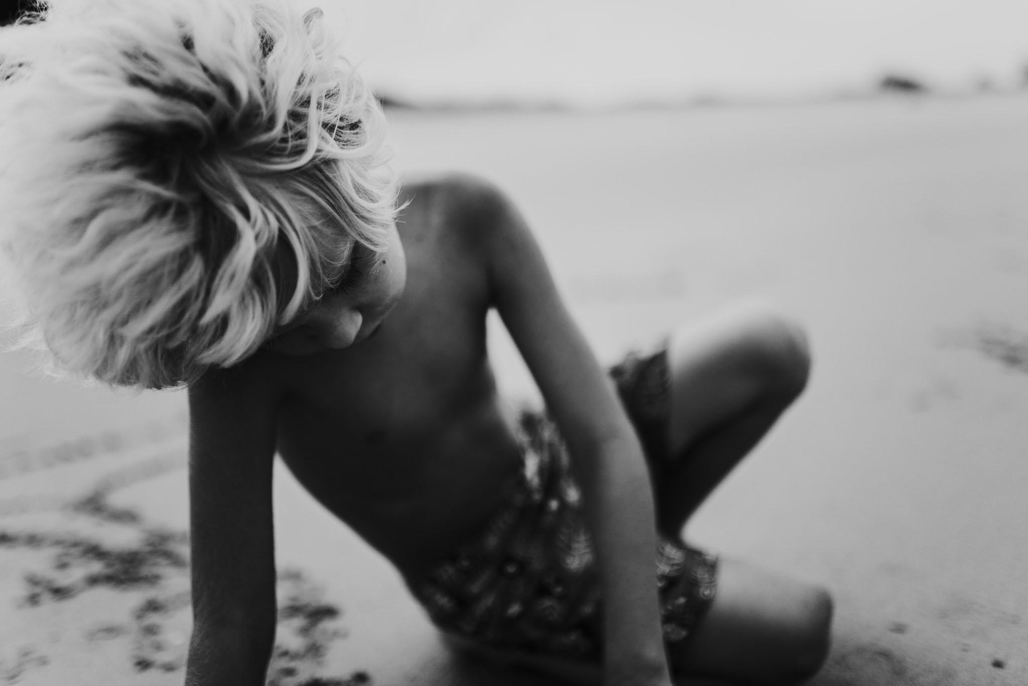 twyla jones photography - treasure coast florida - stormy beach boy playing in sand--30.jpg