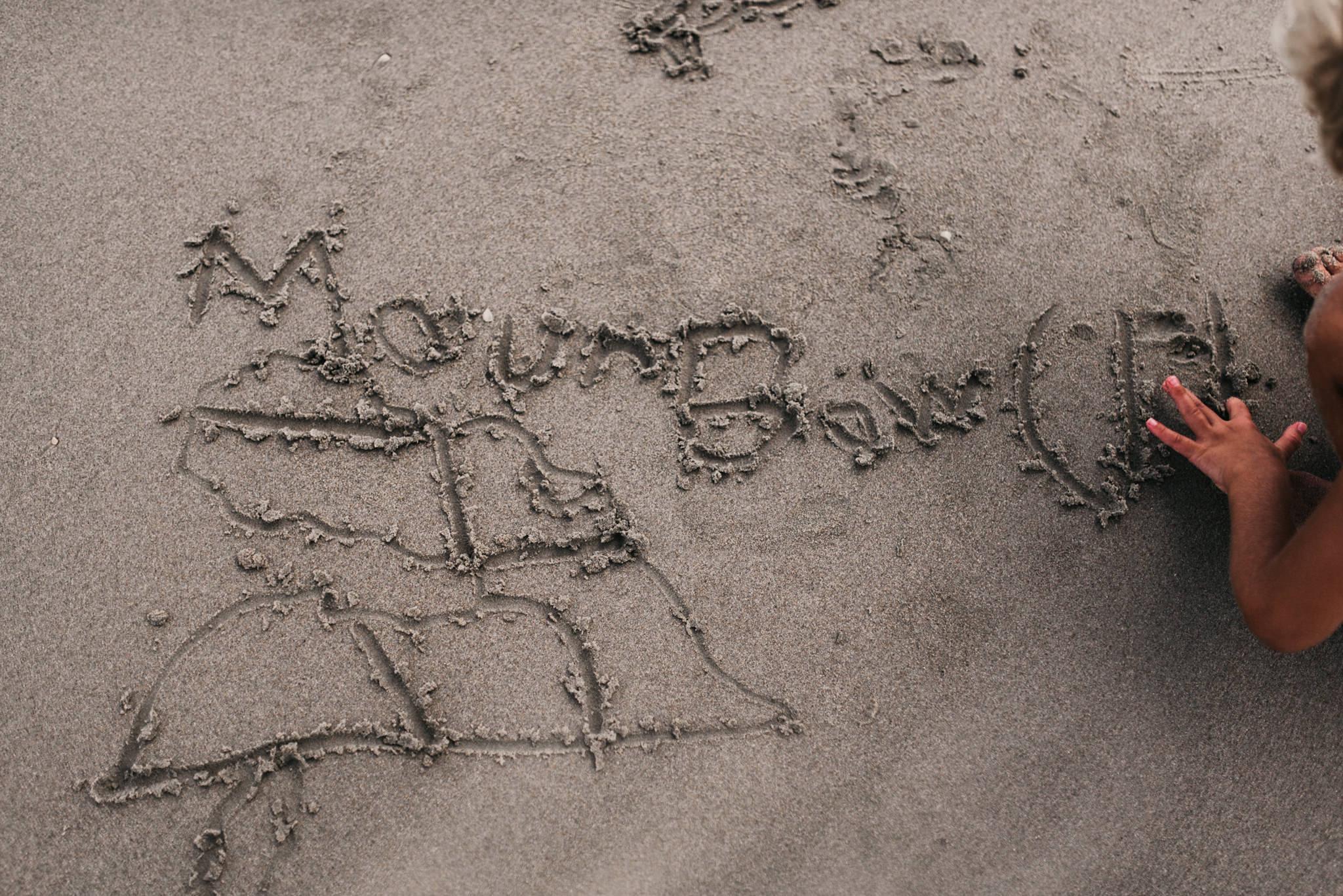 twyla jones photography - treasure coast florida - stormy beach boy playing in sand--31.jpg