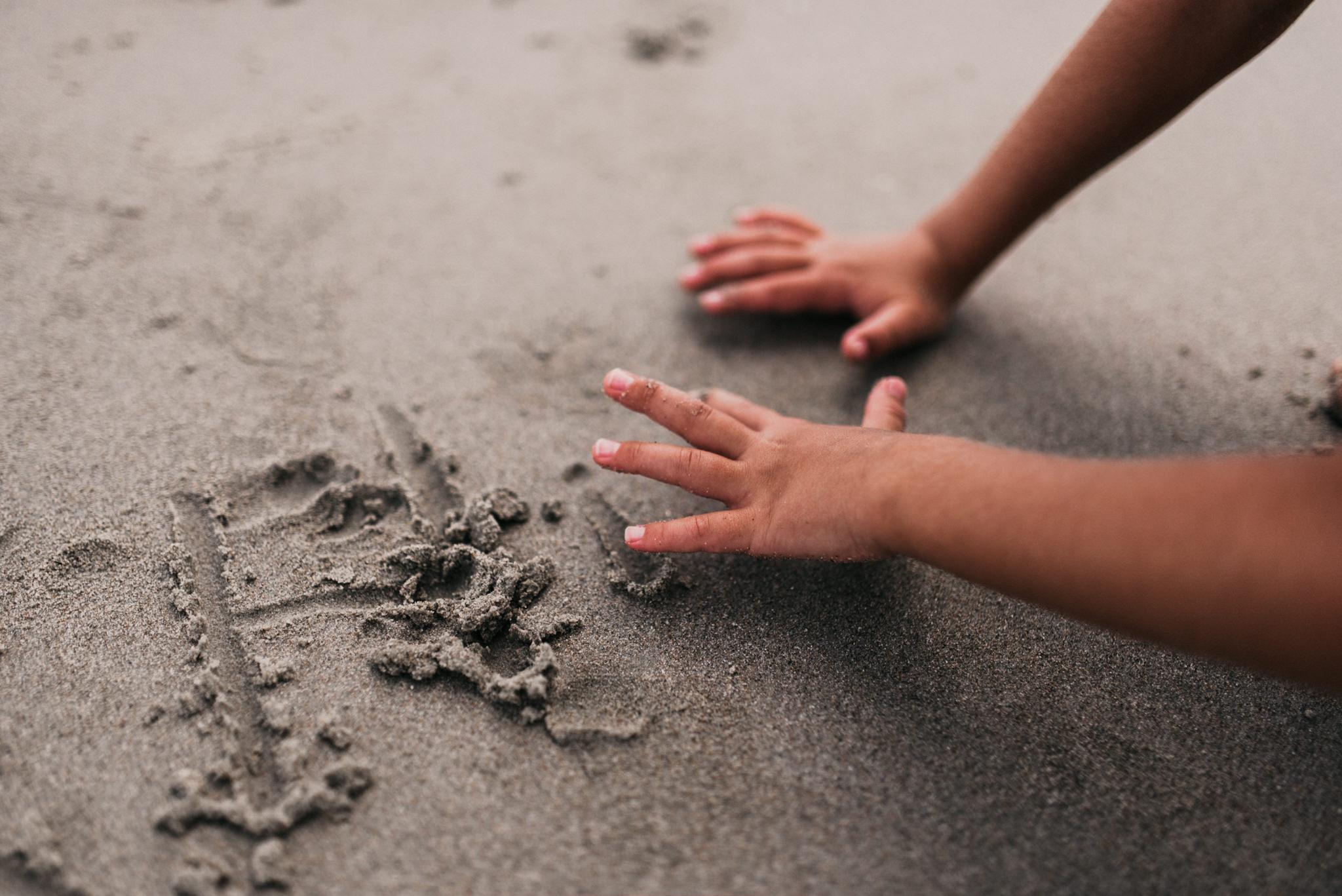 twyla jones photography - treasure coast florida - stormy beach boy playing in sand--32.jpg