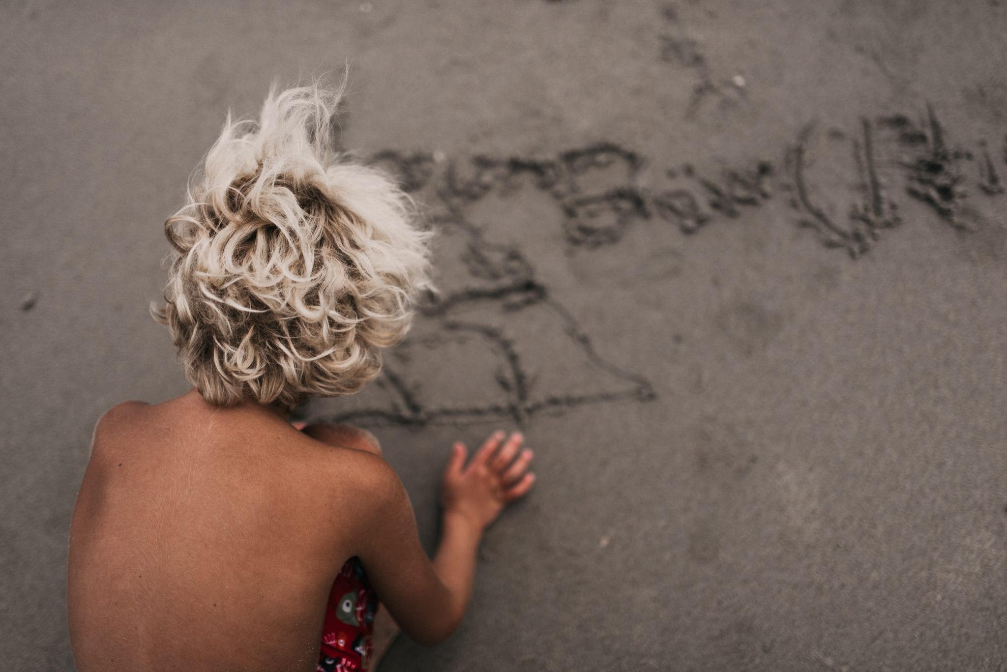 twyla jones photography - treasure coast florida - stormy beach boy playing in sand--34.jpg