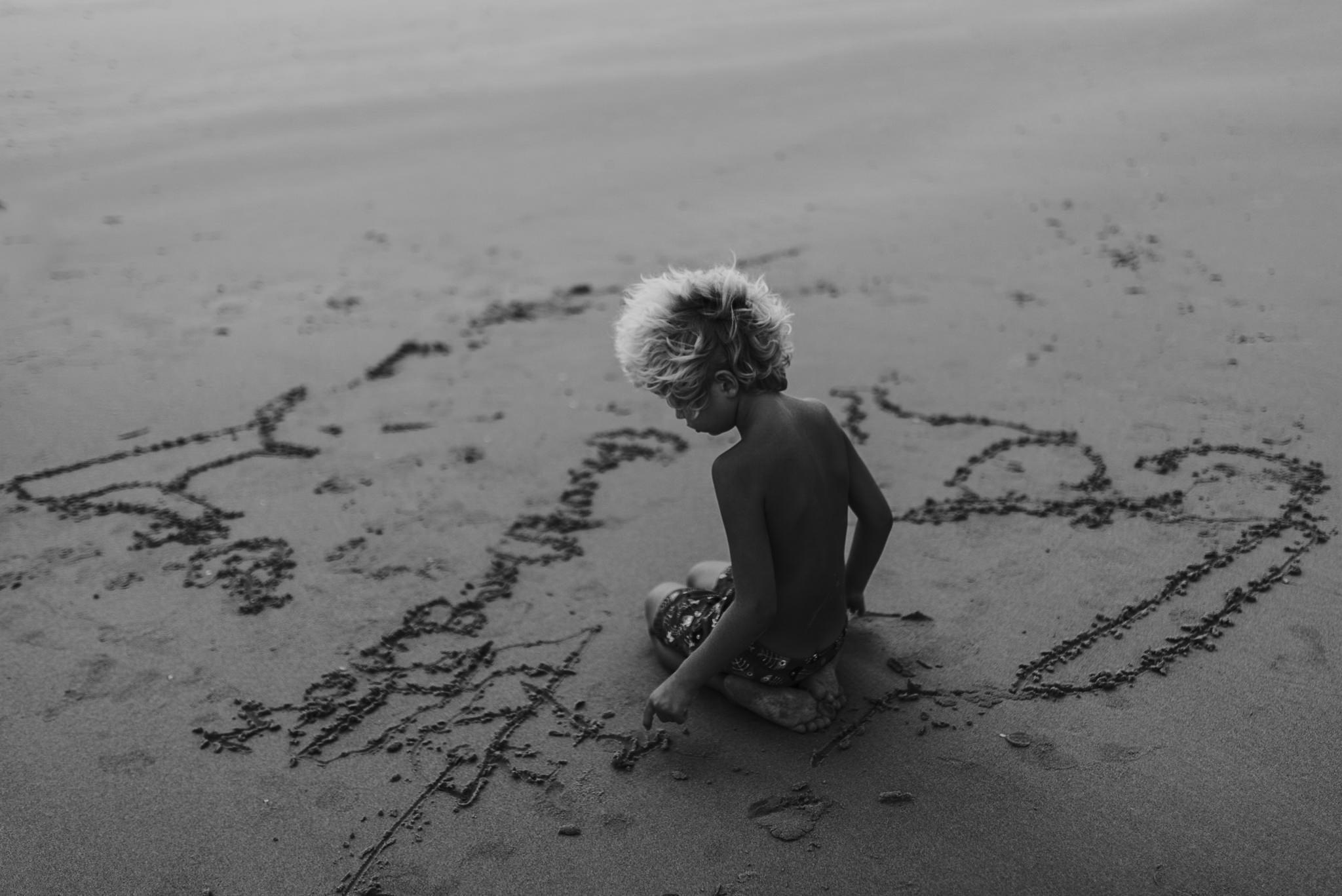twyla jones photography - treasure coast florida - stormy beach boy playing in sand--35.jpg