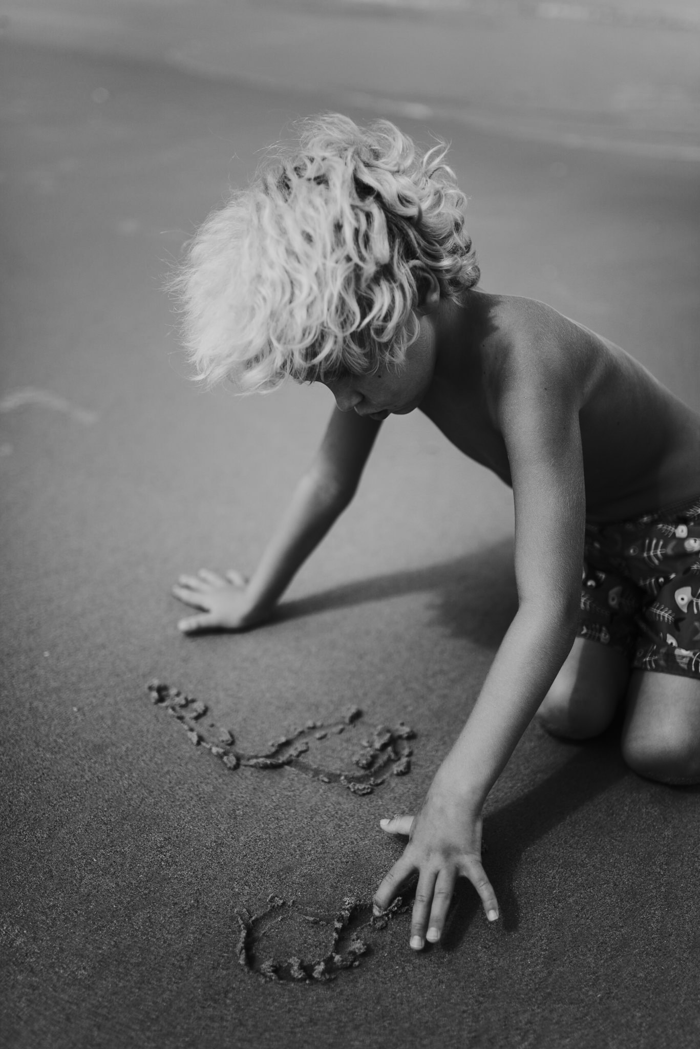 twyla jones photography - treasure coast florida - stormy beach boy playing in sand--12.jpg