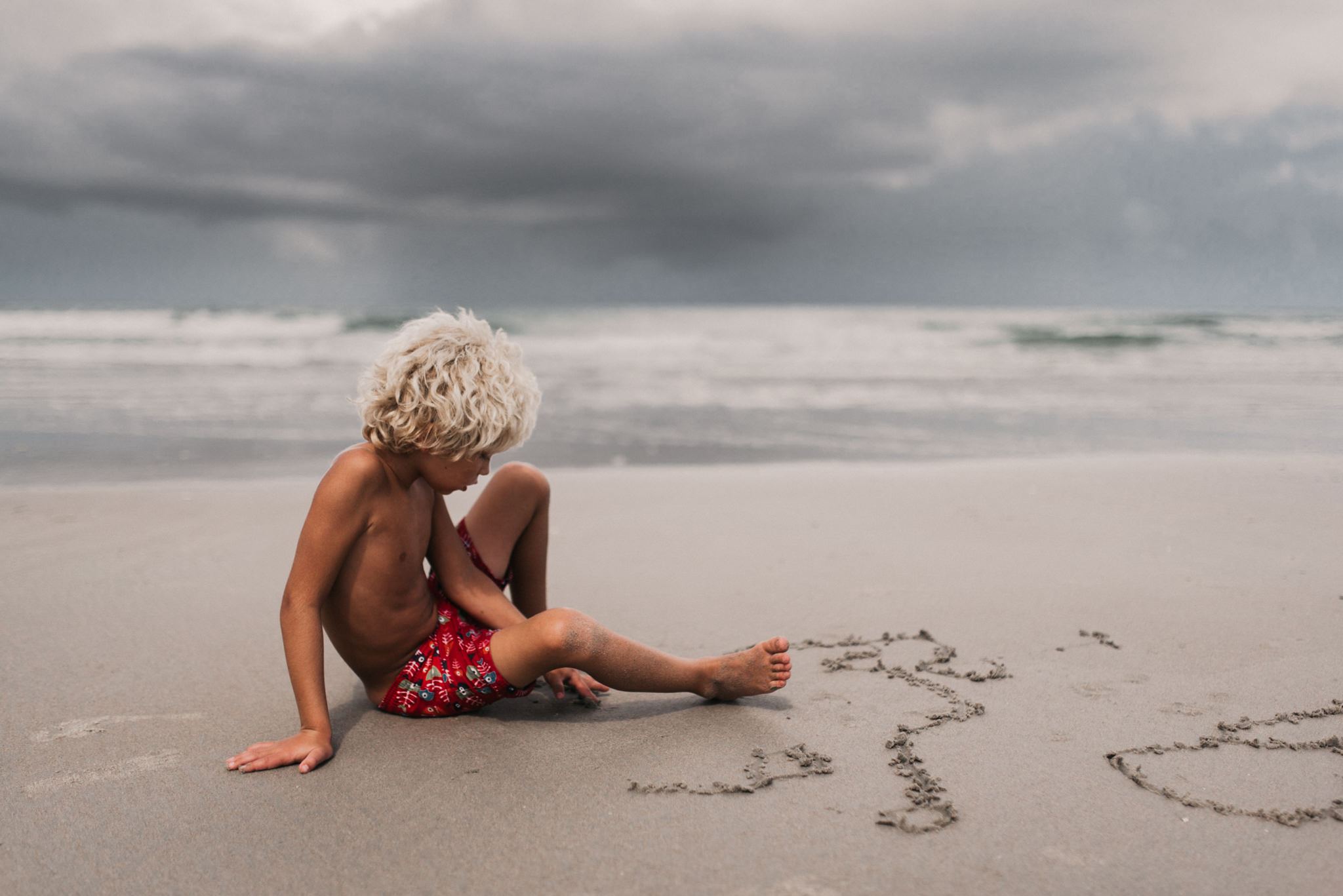 twyla jones photography - treasure coast florida - stormy beach boy playing in sand--13.jpg