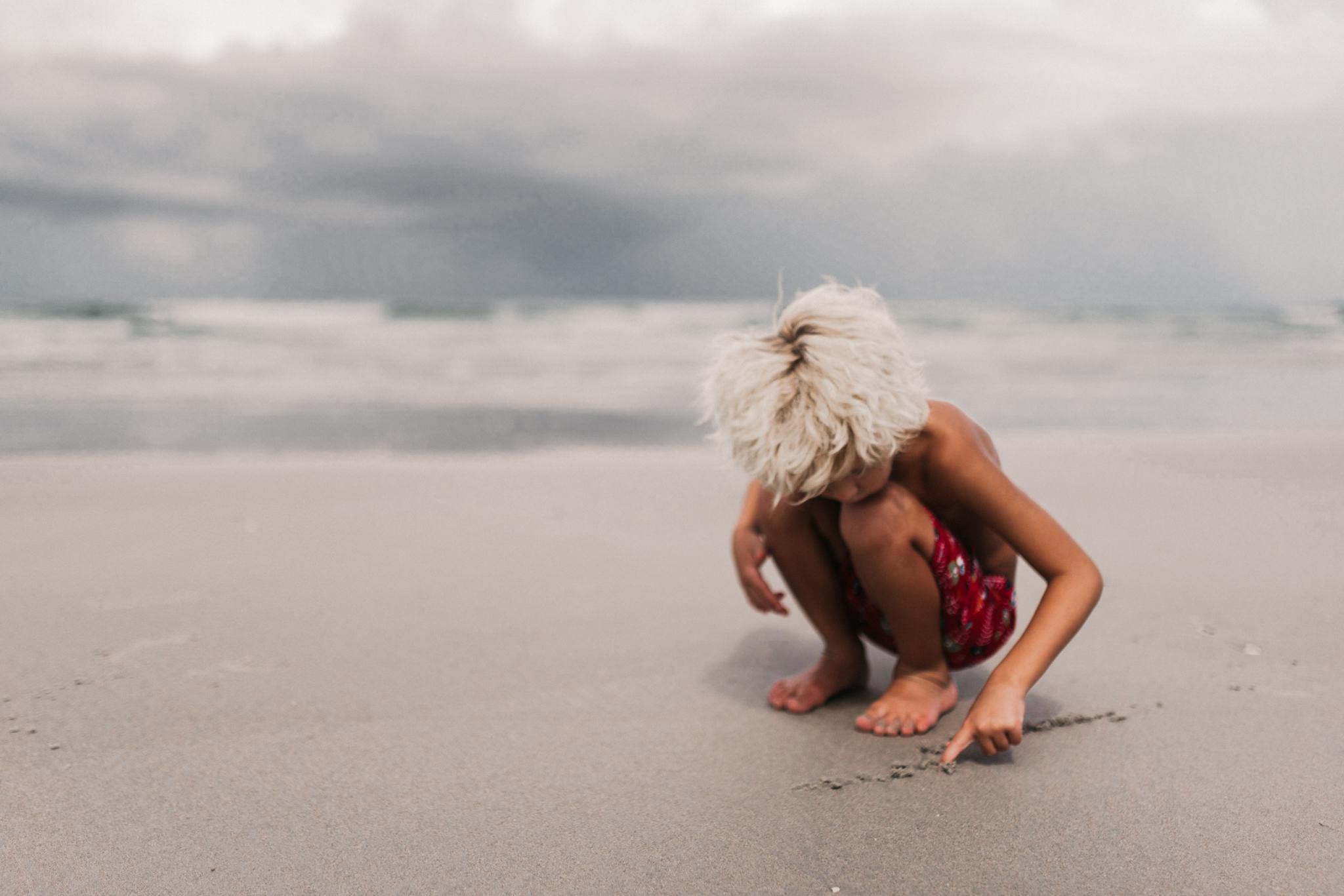 twyla jones photography - treasure coast florida - stormy beach boy playing in sand-2-3.jpg