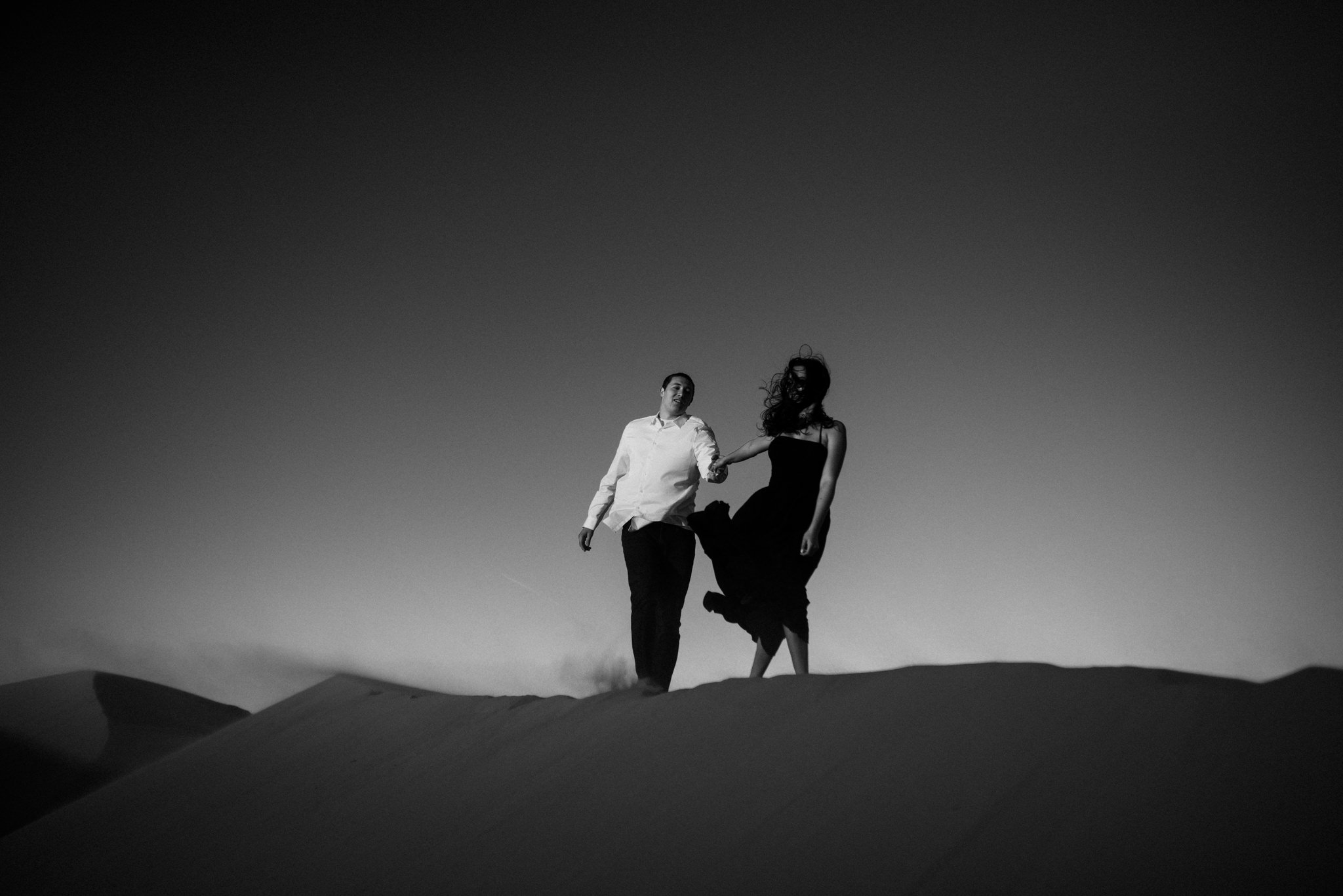 twyla jones photography | couples engagement session sand dunes utah sunset stars-35.jpg