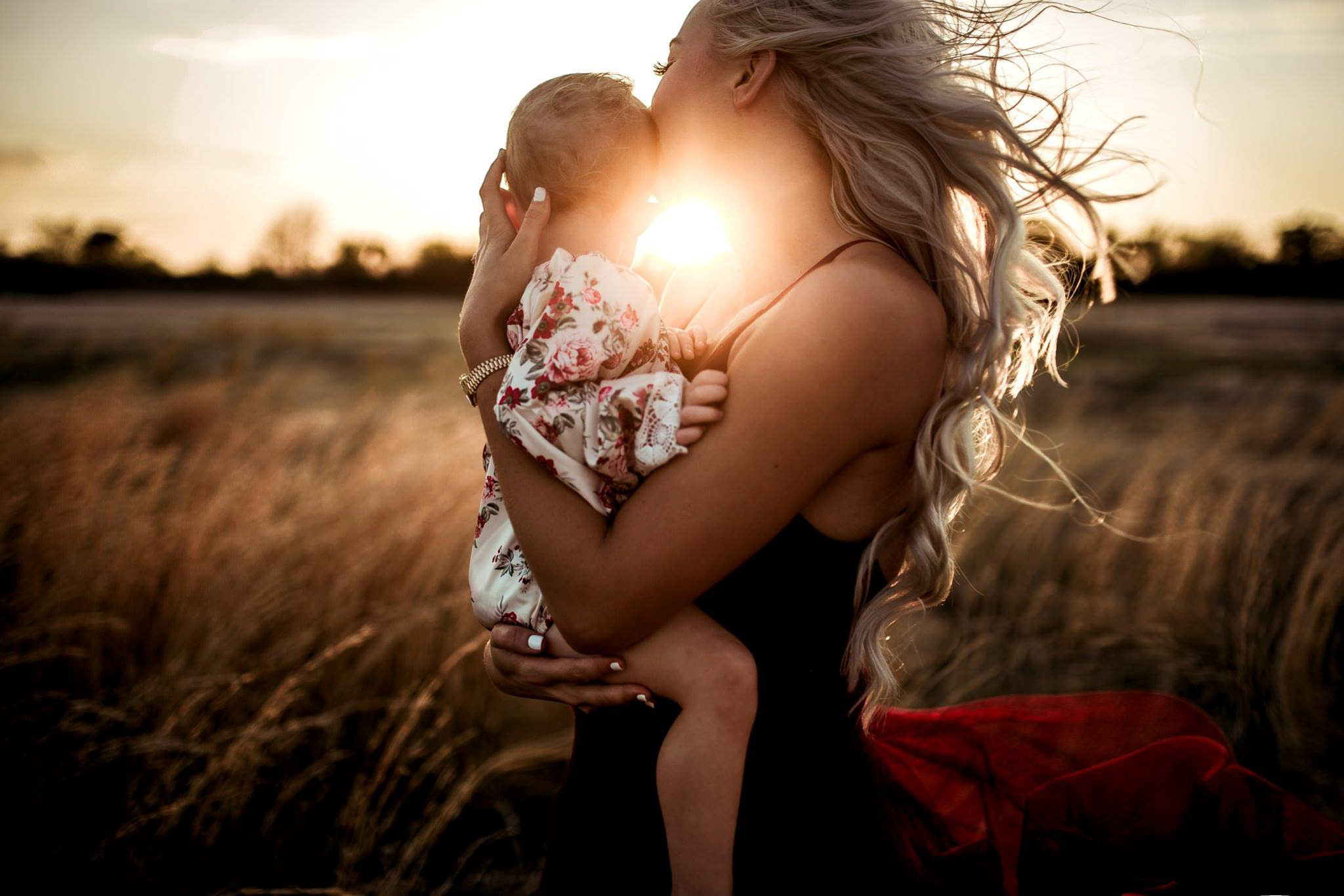 tamra smith horner - emotional storytelling with twyla jones - mother and child embracing in a field at sunset