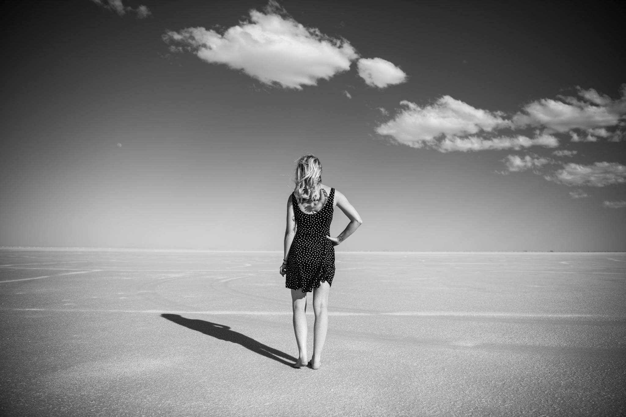 "I rarely do self-portraits, but found myself at some amazing Salt Flats with a camera and dress in the car. It was so interesting/different to try different things and not be afraid to look stupid or have my usual smile. The quote I based these off of: ""I tried to drown my sorrows, but the bastards learned how to swim, and now I am overwhelmed by this decent and good feeling.""  -Karin Willet"