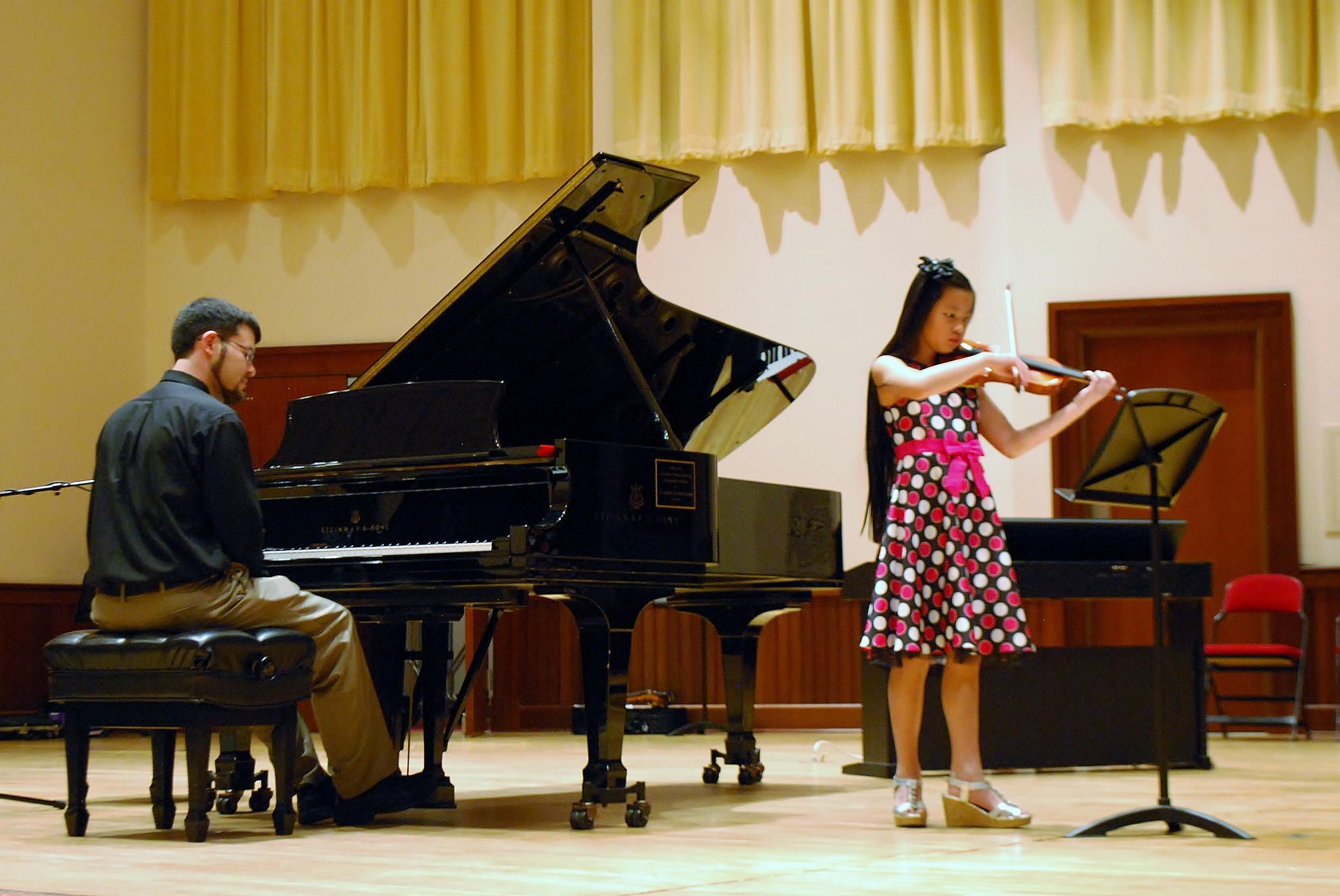Violin student performs at Spring Recital.
