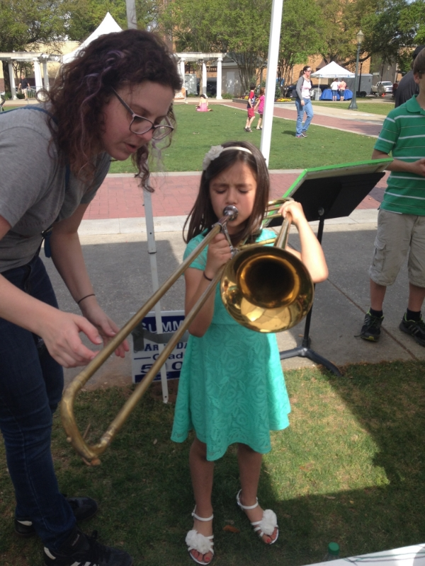 Last year we made a lot of people happy at Arts Alive! Children and adults stopped by to play on over 40 instruments at our booth.