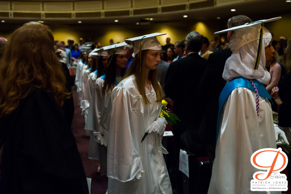 Students Walking with Flowers | Catherine McAuley High School