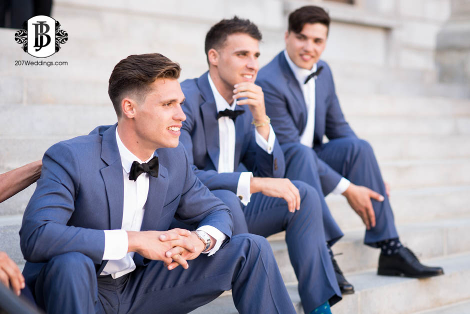 Groomsmen posing on stone steps, taken by their Maine wedding photographer.