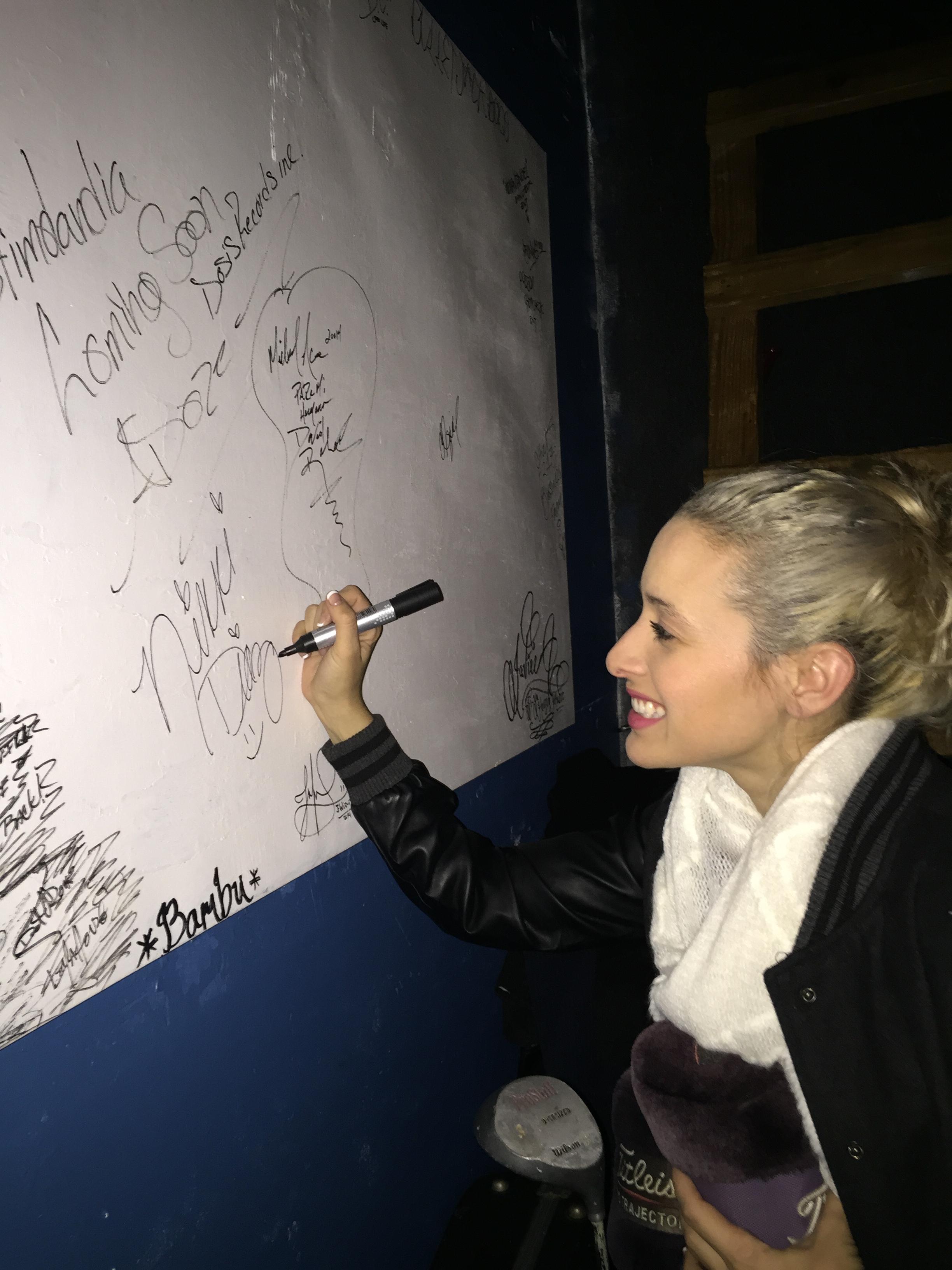 Signing the wall at David Rolas' studio in Los Angeles, CA