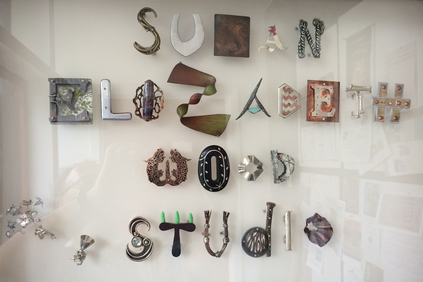 Susan Elizabeth Wood Jewelry Studio door sign.  Each letter is handmade by over 20 artists,