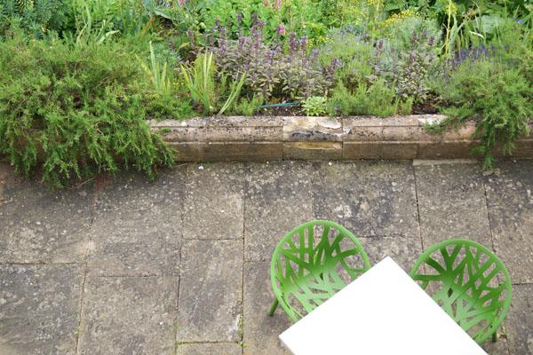 Cowley-Manor-chairs-on-terrace-Design-Hunter.jpg