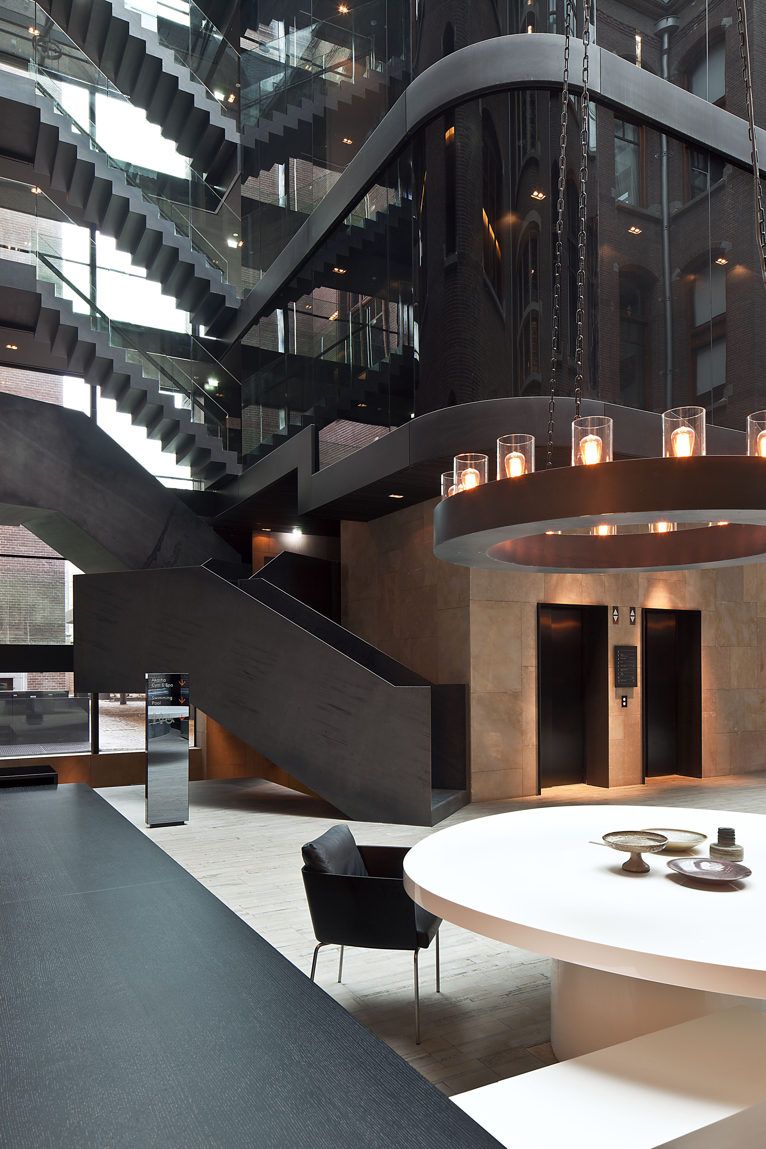 Contemporary architectural steel staircase at The Conservatorium Hotel Amsterdam | Design Hunter