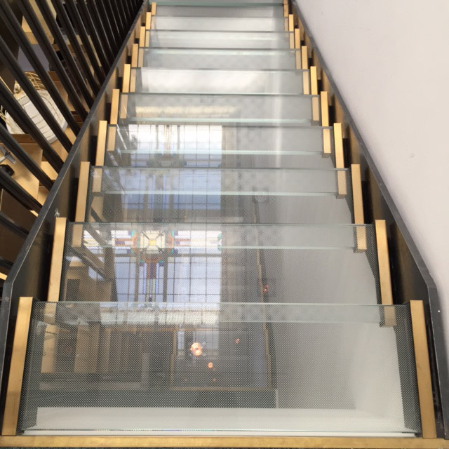 Glass and brass staircase at Vesper Hotel | Design Hunter