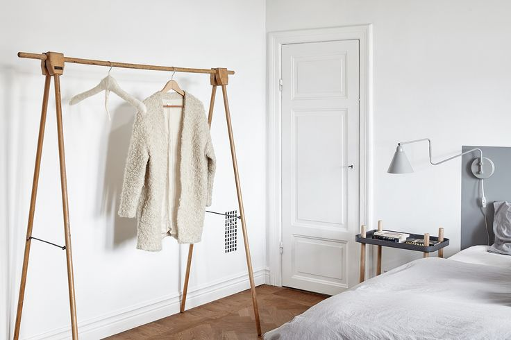 White Scandinavian home with herringbone parquet flooring