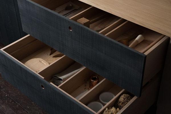 Interior of stained black kitchen drawer - Sebastian Cox for deVOL