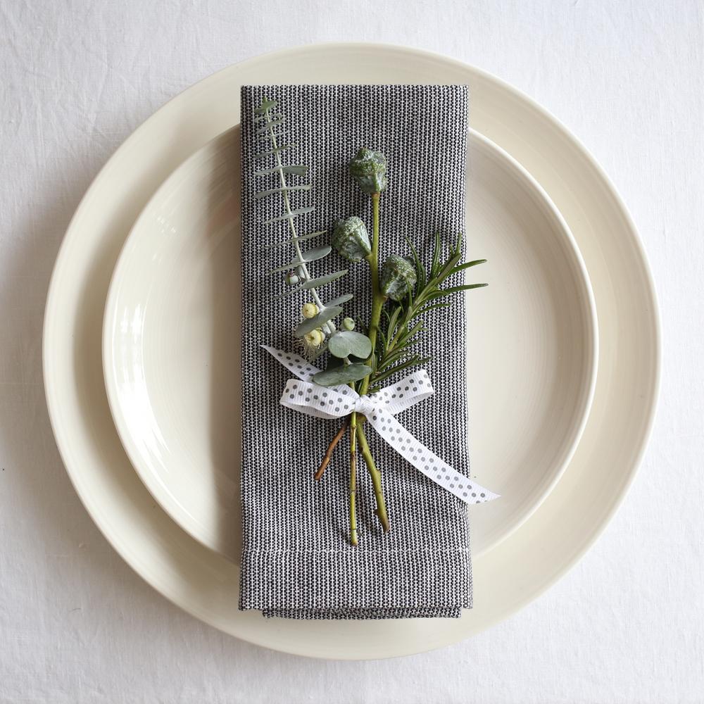 Christmas place setting with grey napkins & eucalyptus | Design Hunter