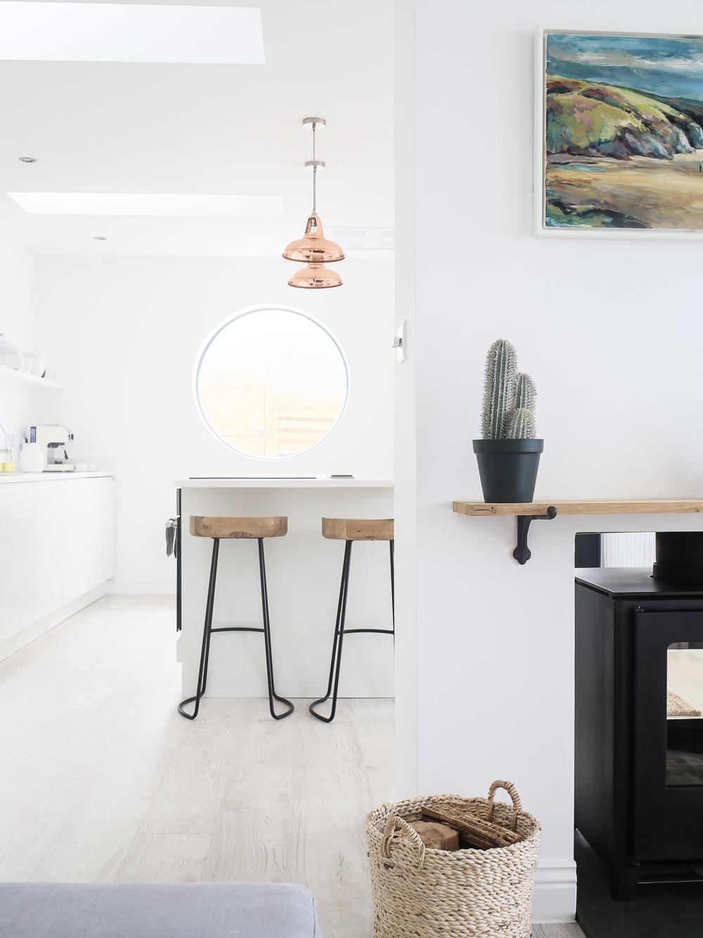 Kitchen island with copper pendant lights   Design Hunter