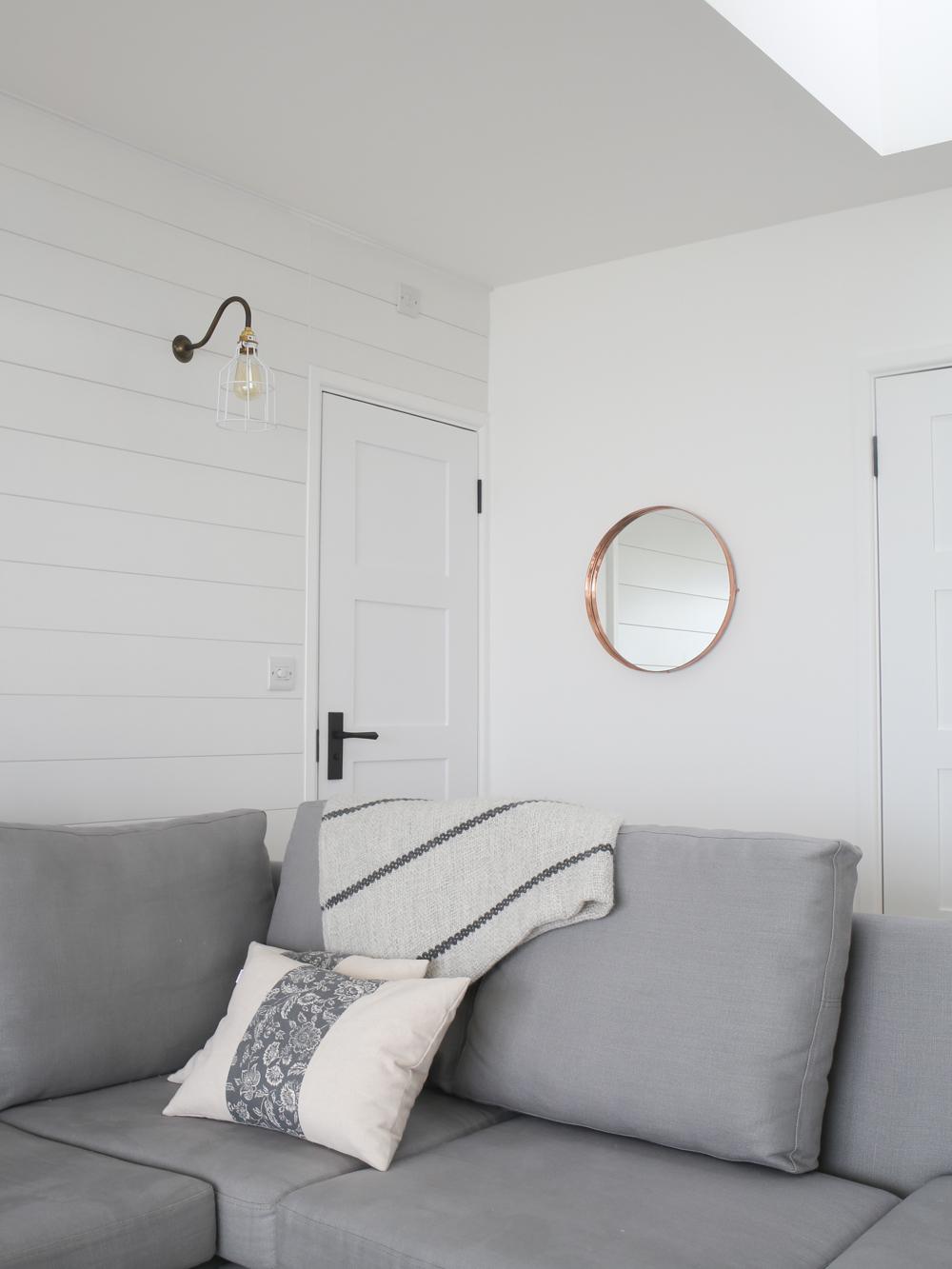 Grey sofa & copper mirror | Design Hunter