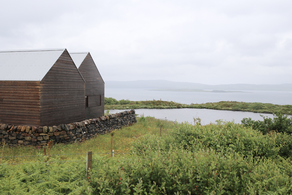 Stone and larch single storey house on the Isle of Skye by Dualchas Architects