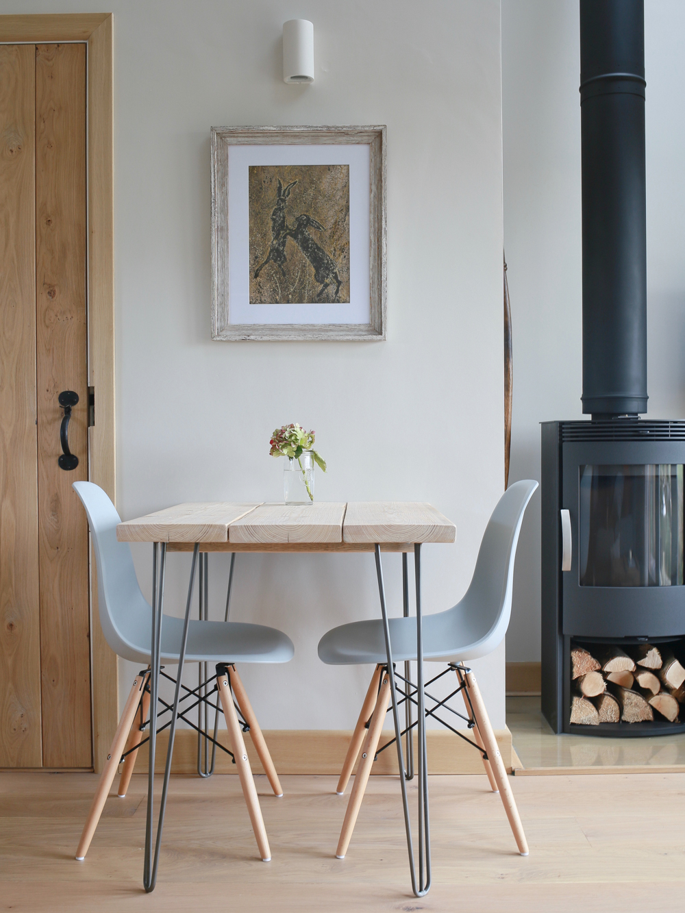 woodburner and eames chairs
