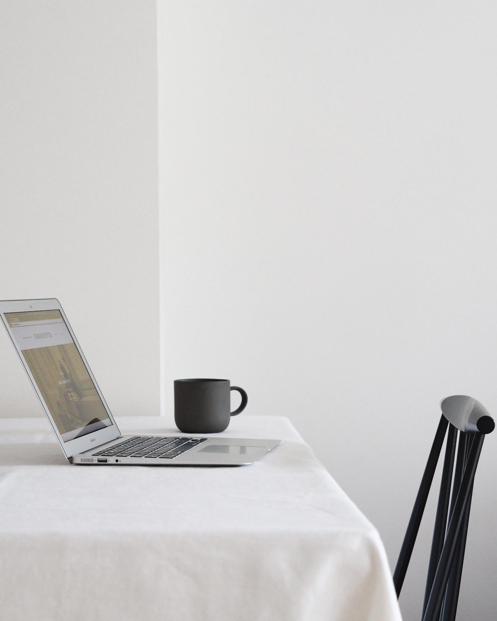 Laptop and mug on table