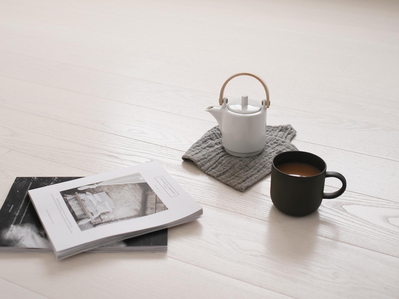 Tea on white ash studio floor | Design Hunter