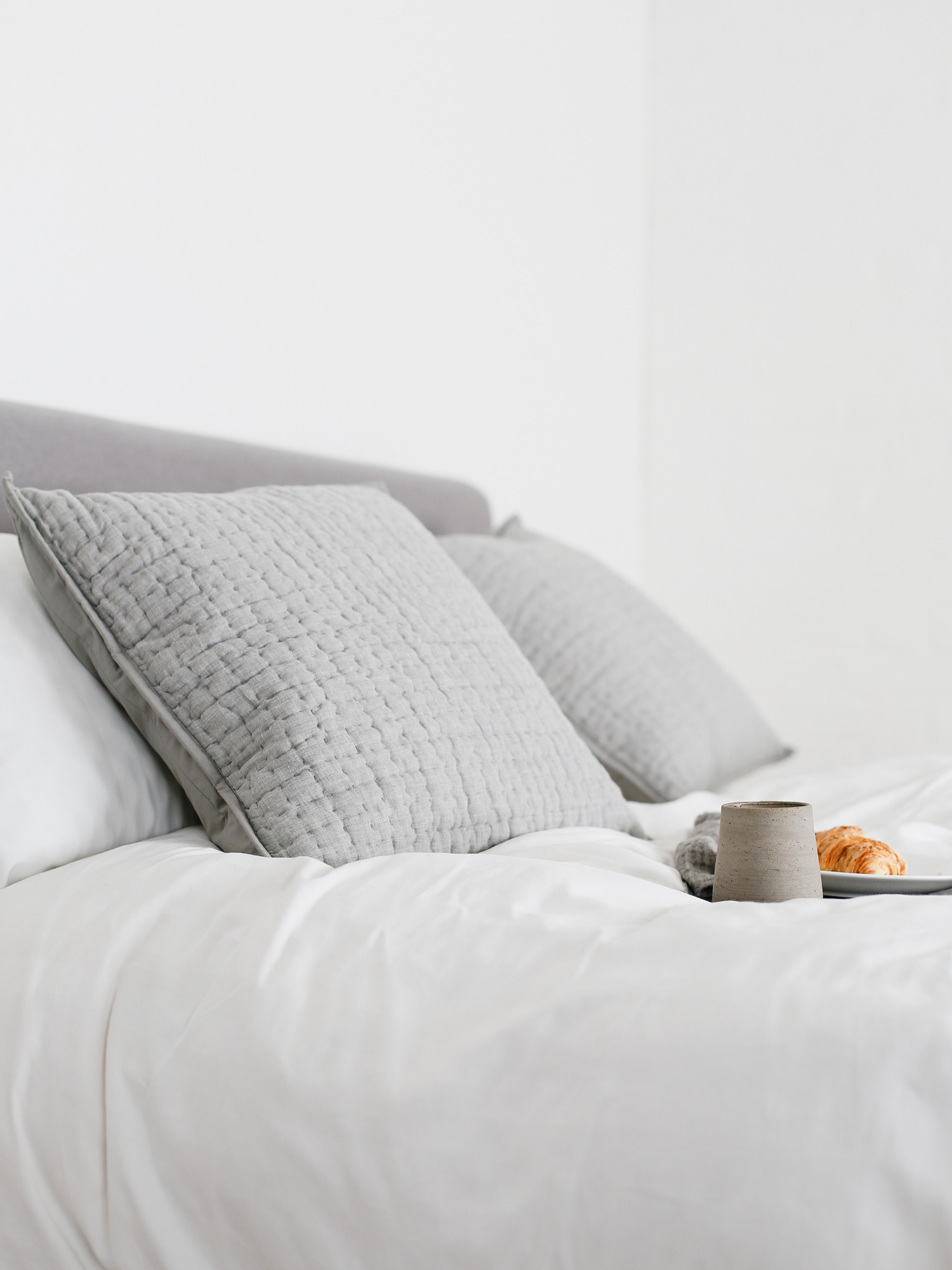 Croissant and grey pillows