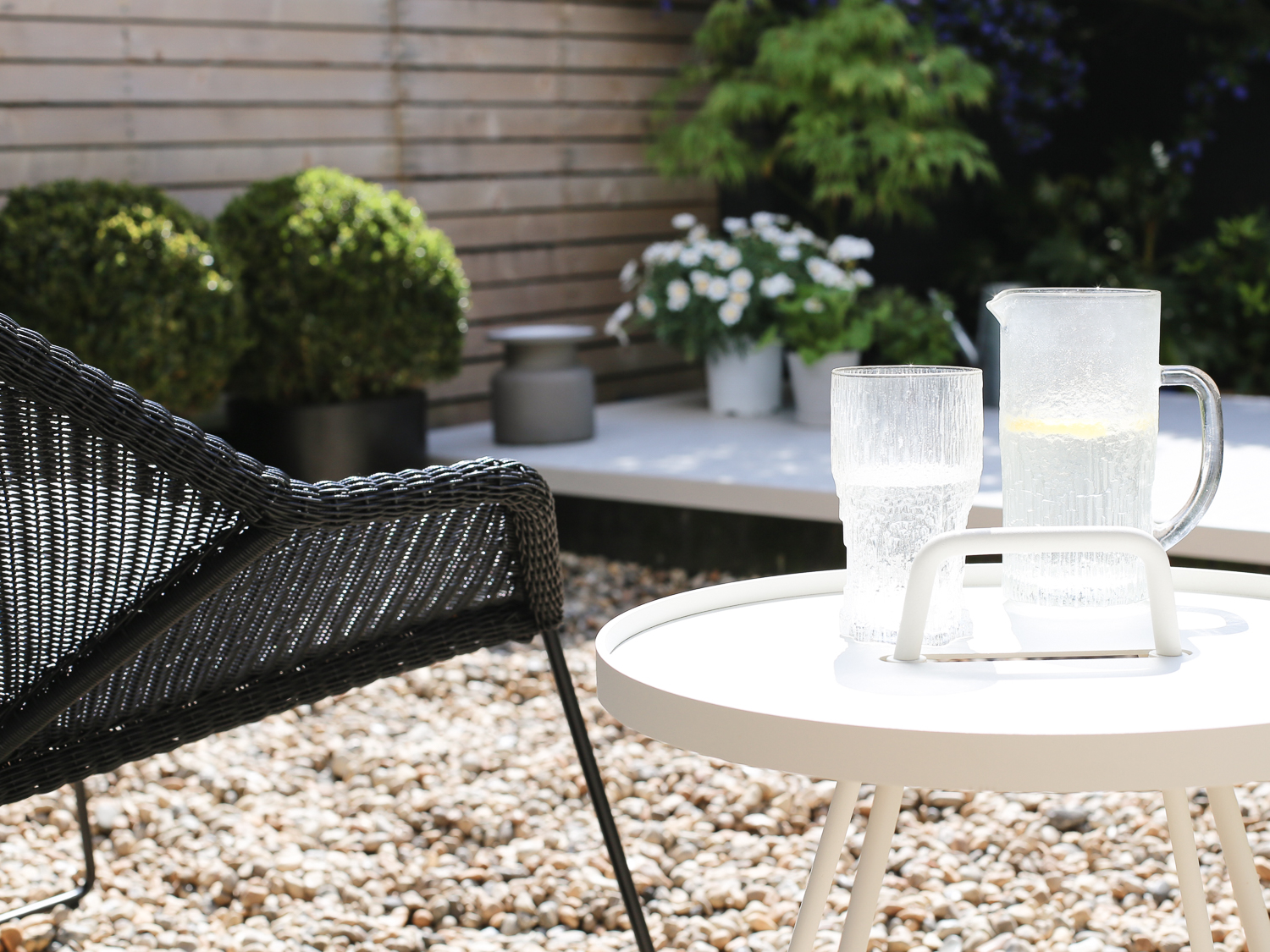Cane-line table and garden chair | Design Hunter