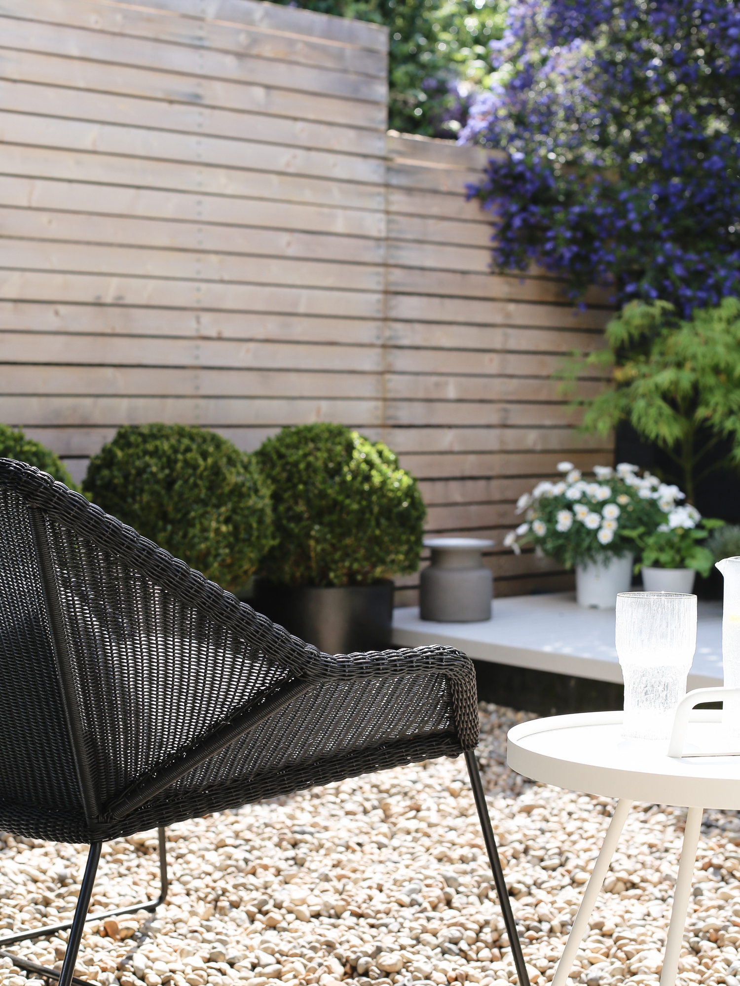 Cane-line table and outdoor chair | Design Hunter