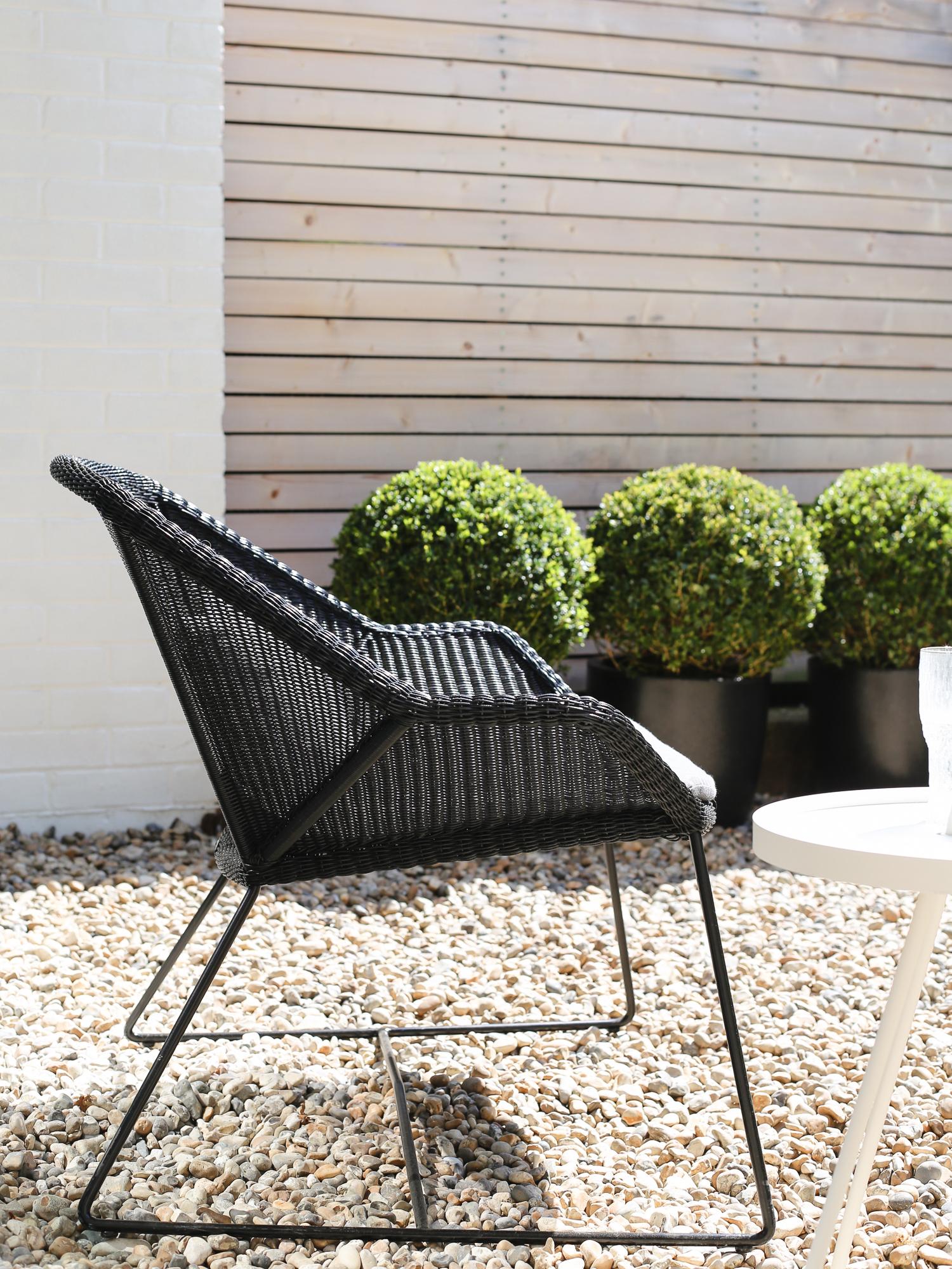 Black rattan chair by Cane-line | Design Hunter