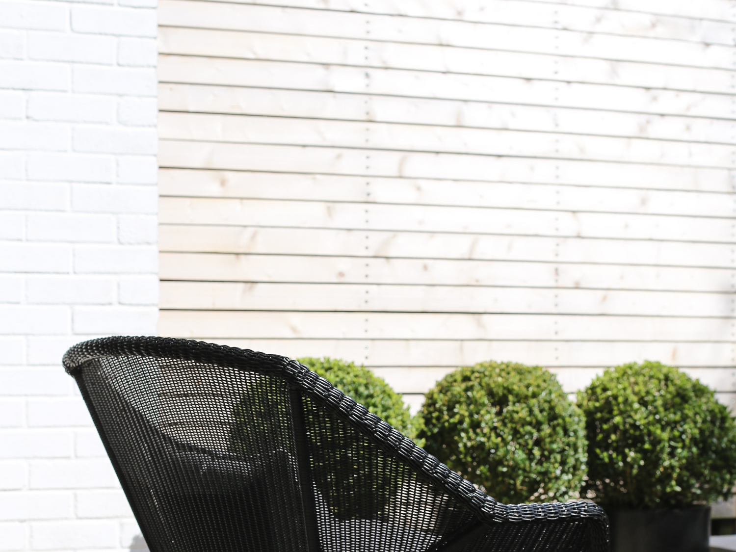 Close up detail of garden chair and box topiary balls | Design Hunter