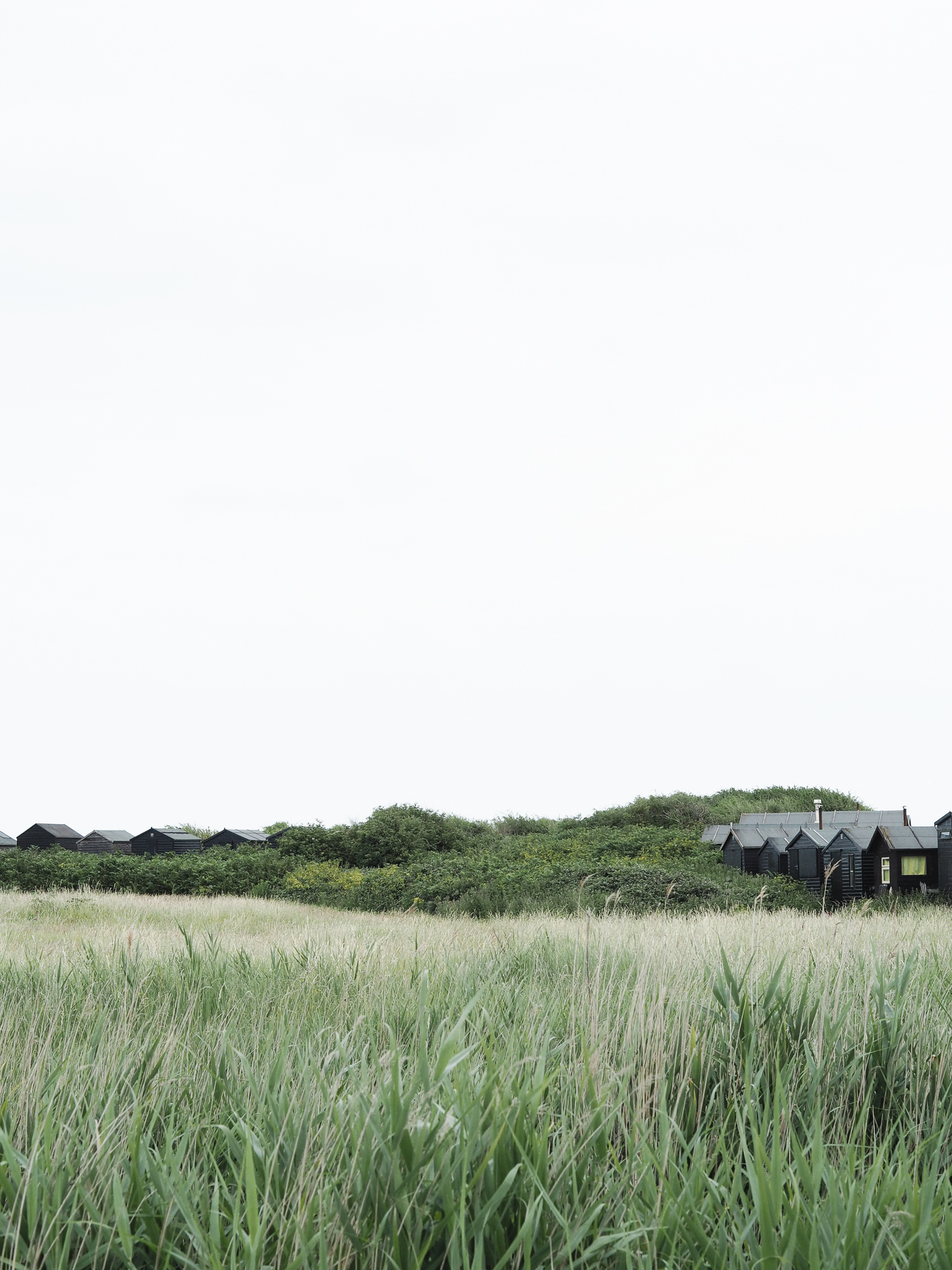 Black beach huts at Walberswick in Suffolk | Design Hunter