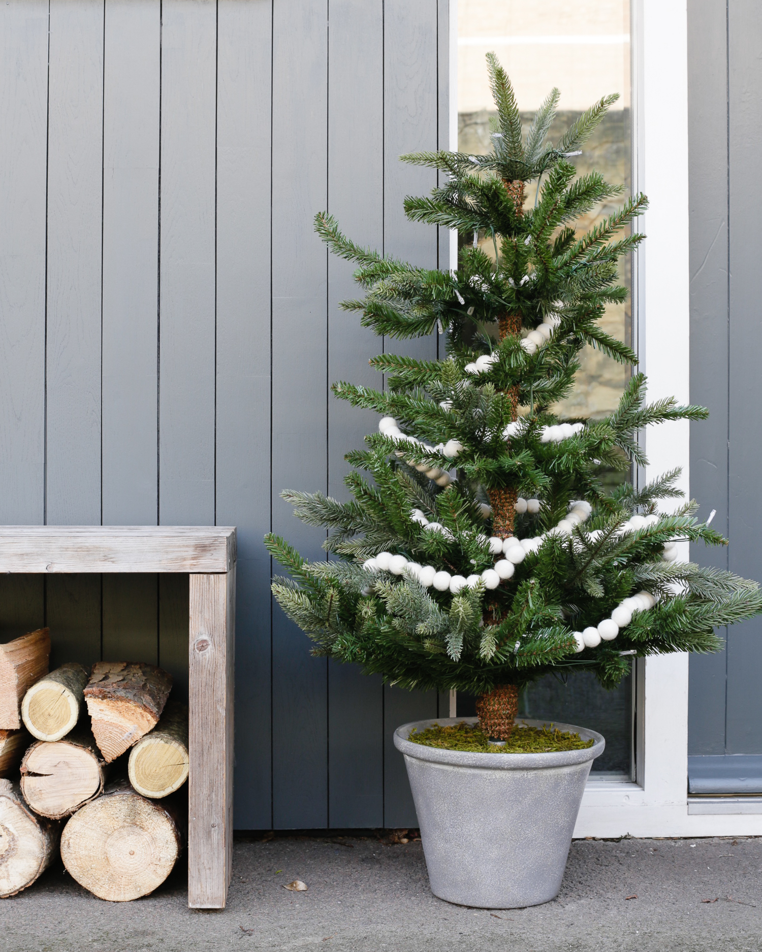 Festive door with Christmas tree by The White Company | Design Hunter