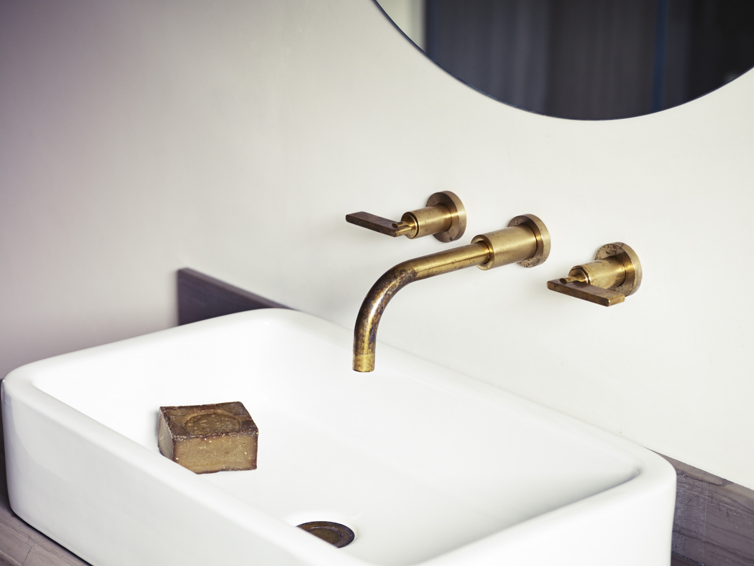 Wall mounted brass taps by Studio Ore