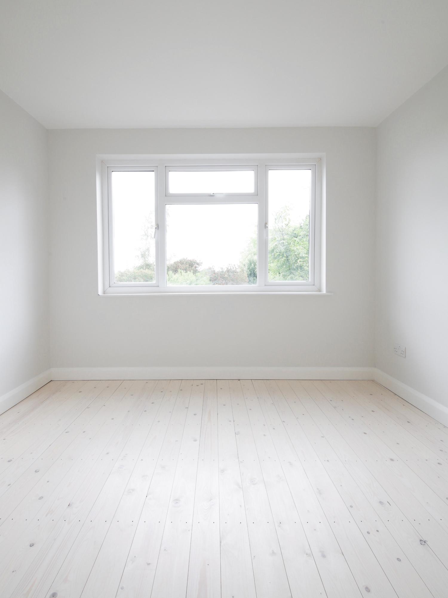 Freshly plastered room with pale wood flooring | Design Hunter