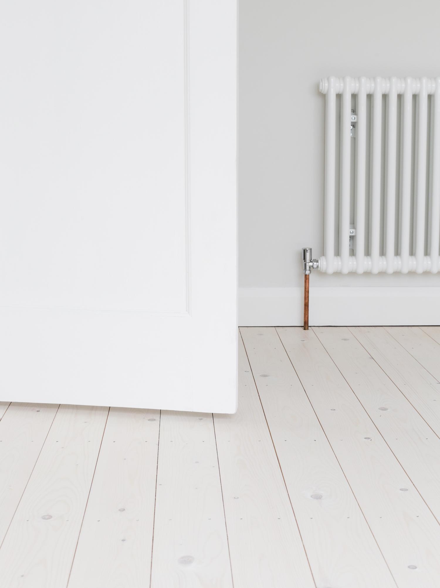 Acova column radiator and pale wood flooring | Design Hunter