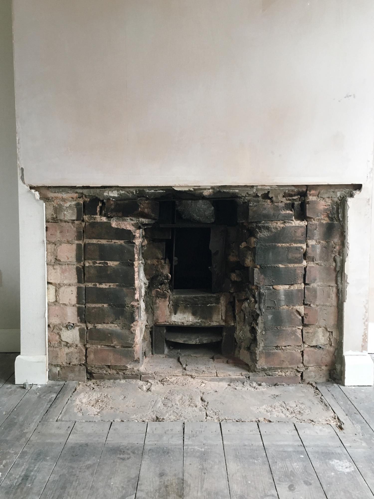 Removing the fireplace for a woodburner.jpg