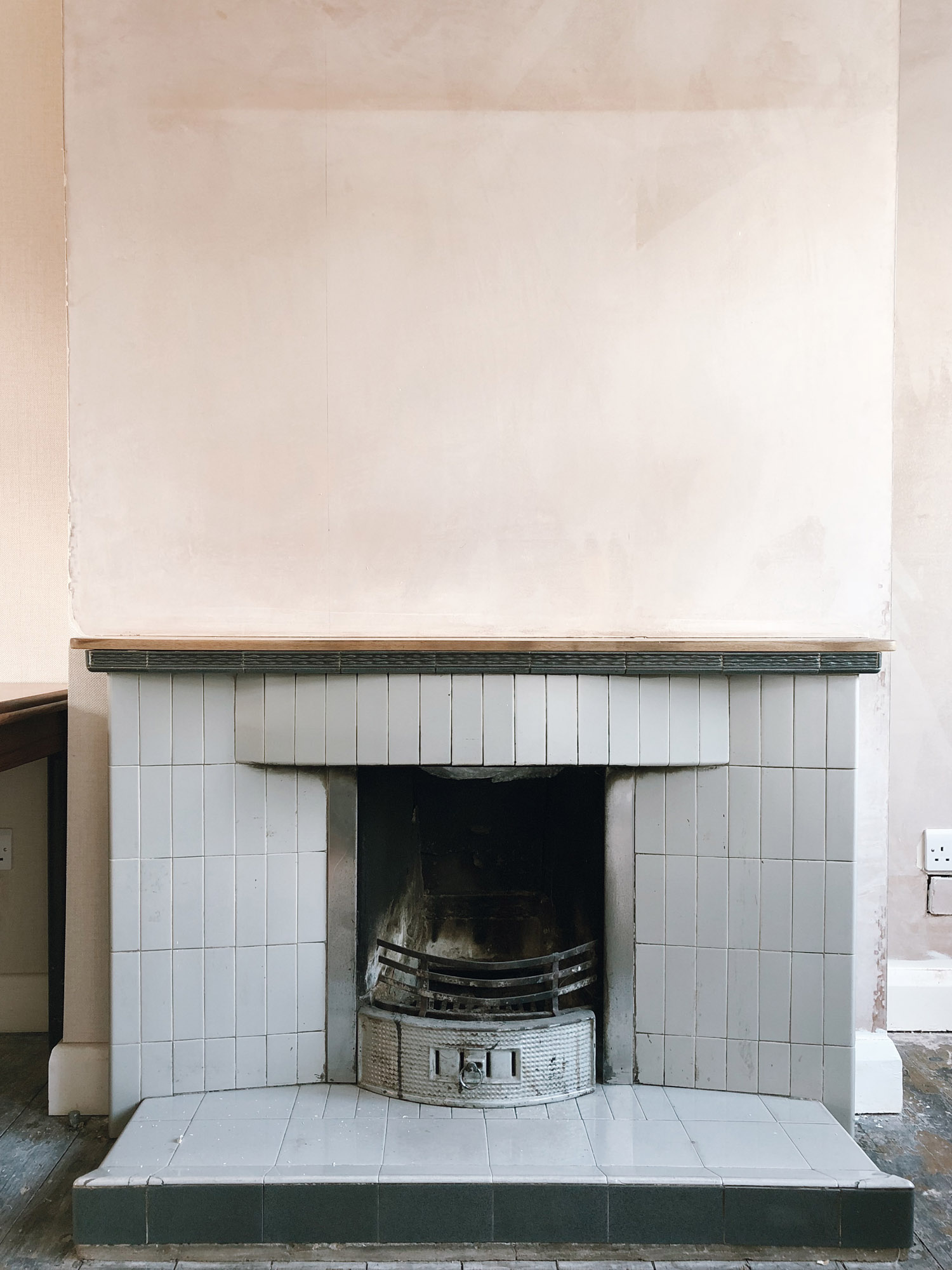 The original 1930s fireplace in our living room before and after we removed it.