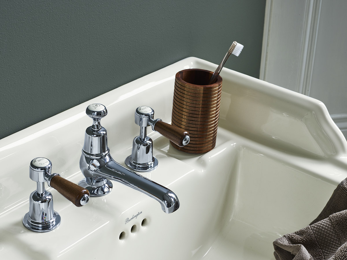 Ivory Medici basin and Kensington taps with Walnut trim by Burlington